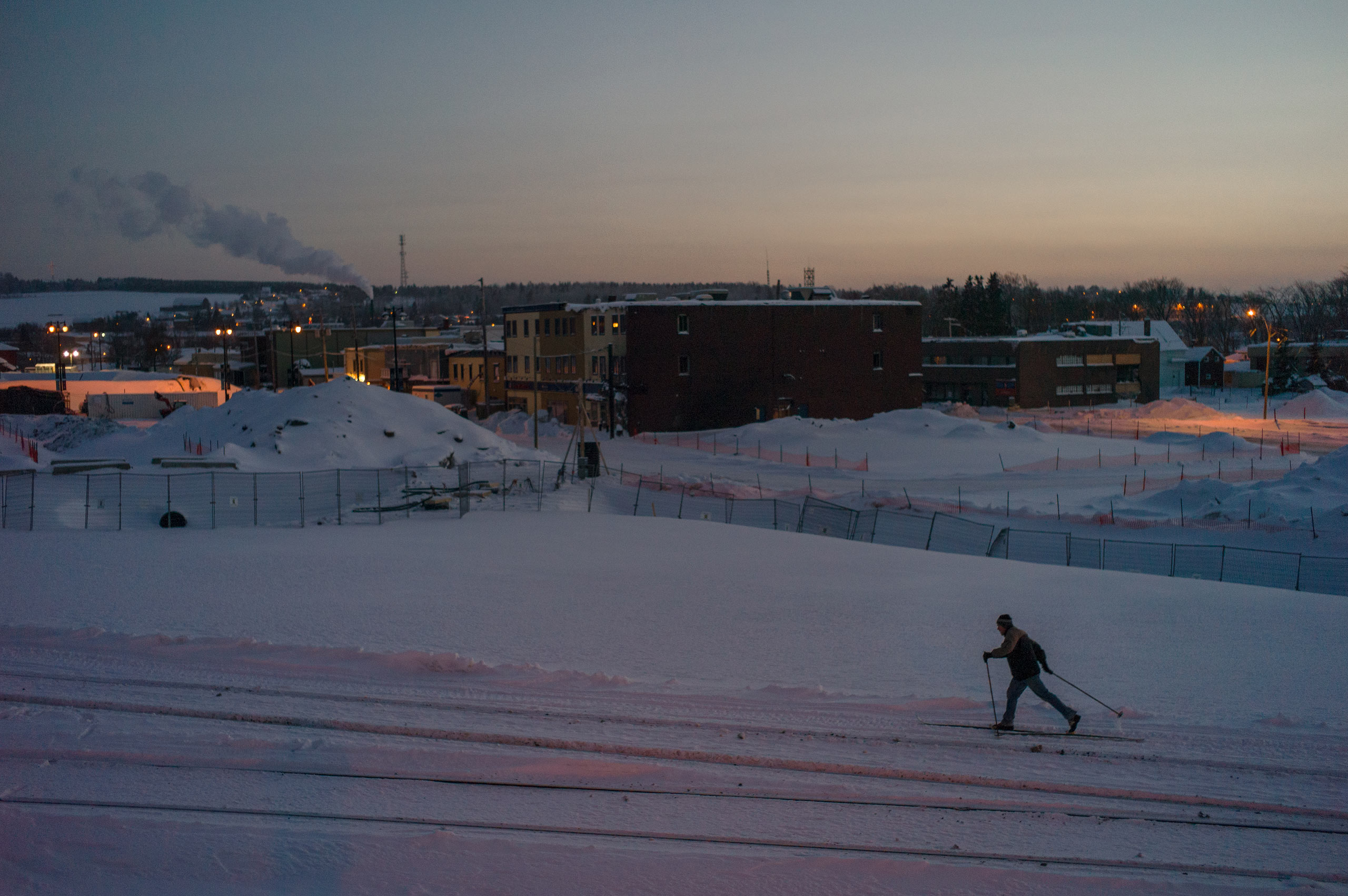 A cross-country skier on the rehabilitated train tracks next to the still-closed Red Zone. Dec. 31, 2013.