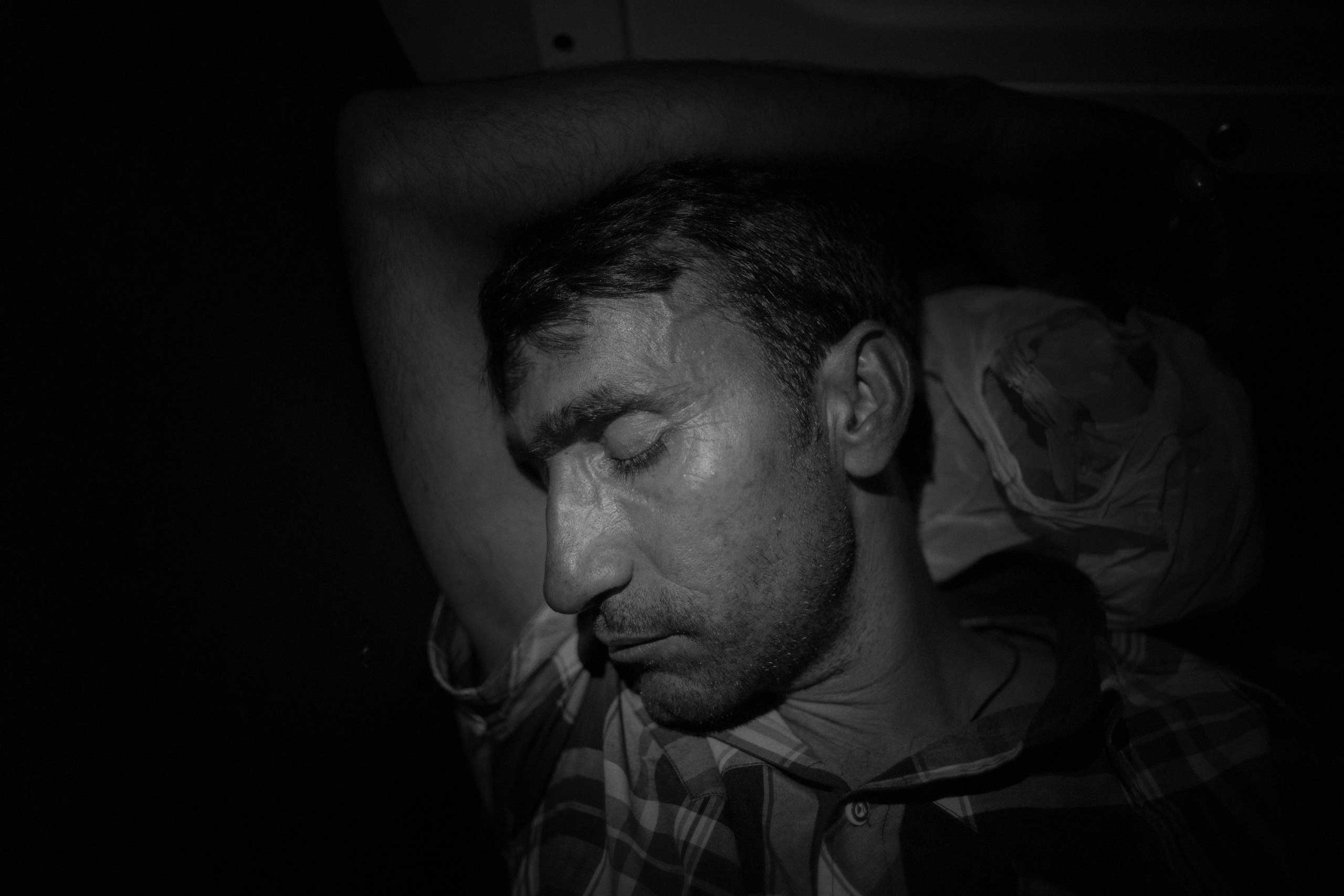A man from Syria sleeps on the local train that from Gevdelija, on the Macedonian-Greek border, will bring him to Tabanovce, on the Serbian border.