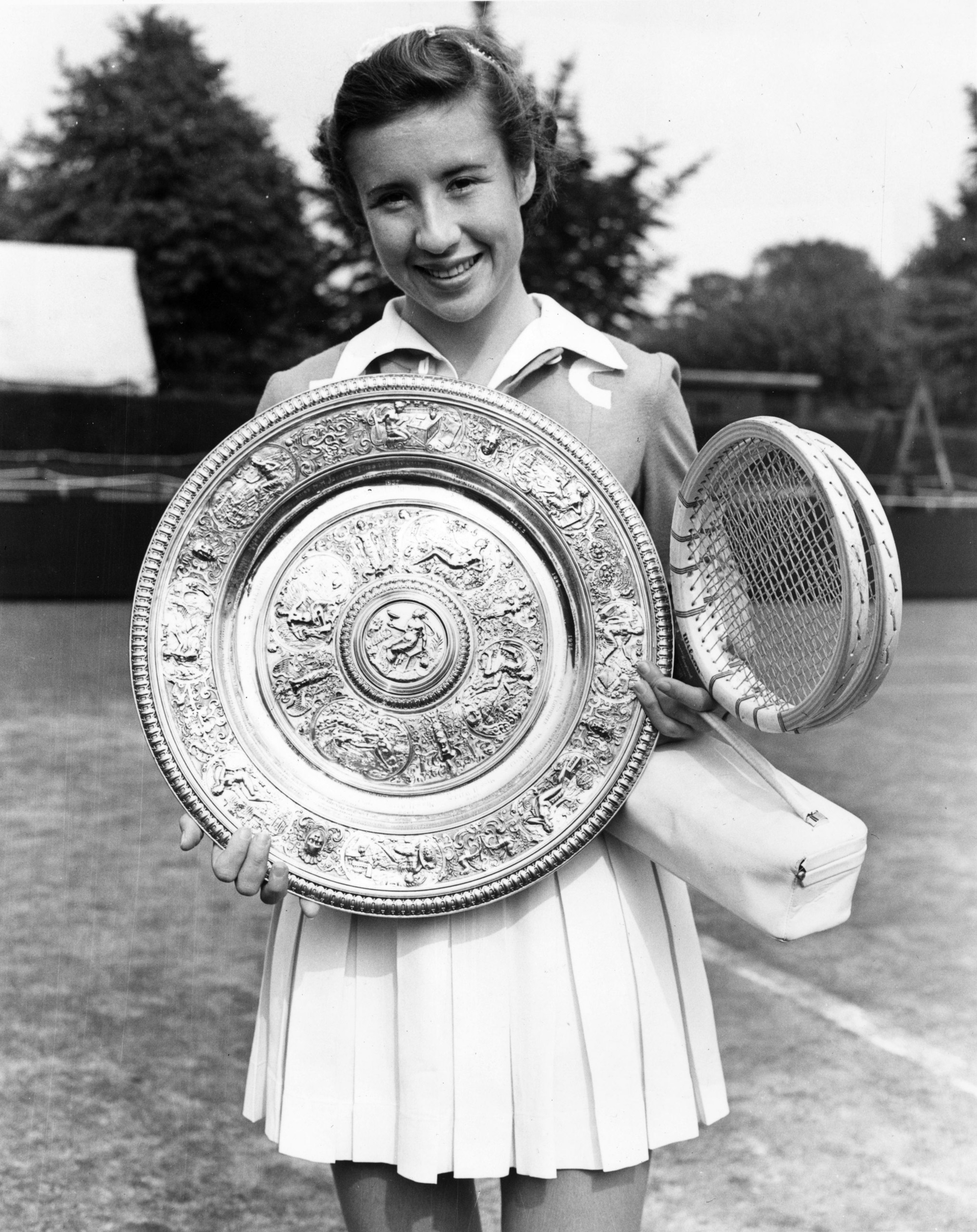 American tennis player Maureen Connolly (Little Mo) with the women's singles trophy after beating Doris Hart in the final at the Wimbledon Lawn Tennis Championships, July 1953.