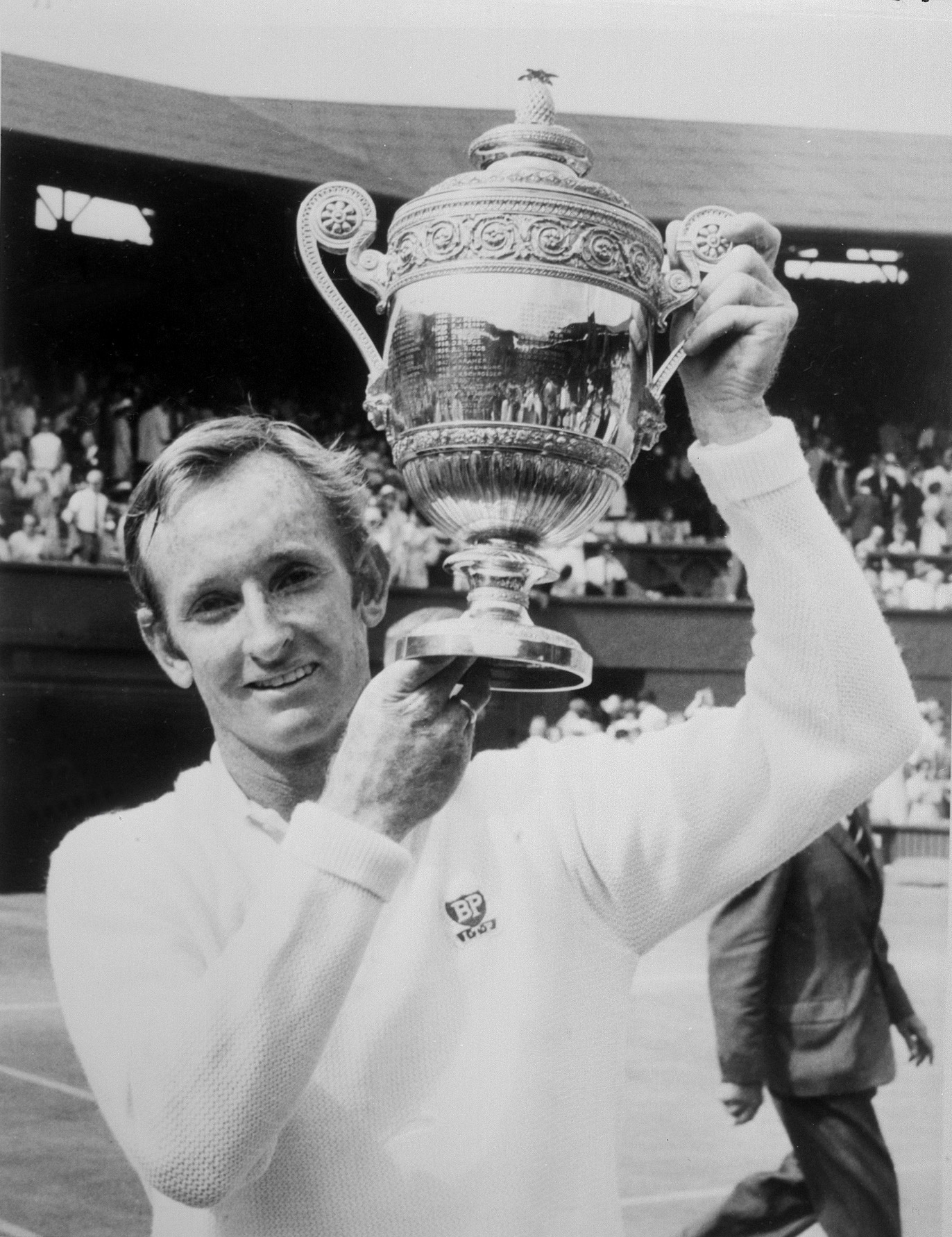 Australian tennis champion Rod Laver holds up the Wimbledon International tournament single men's trophy that he won, four-time consecutively, against his country fellow Tony Roche. Champion of the champions, Rod Laver is the one man to have won two grand slams, in 1962 and in 1969.