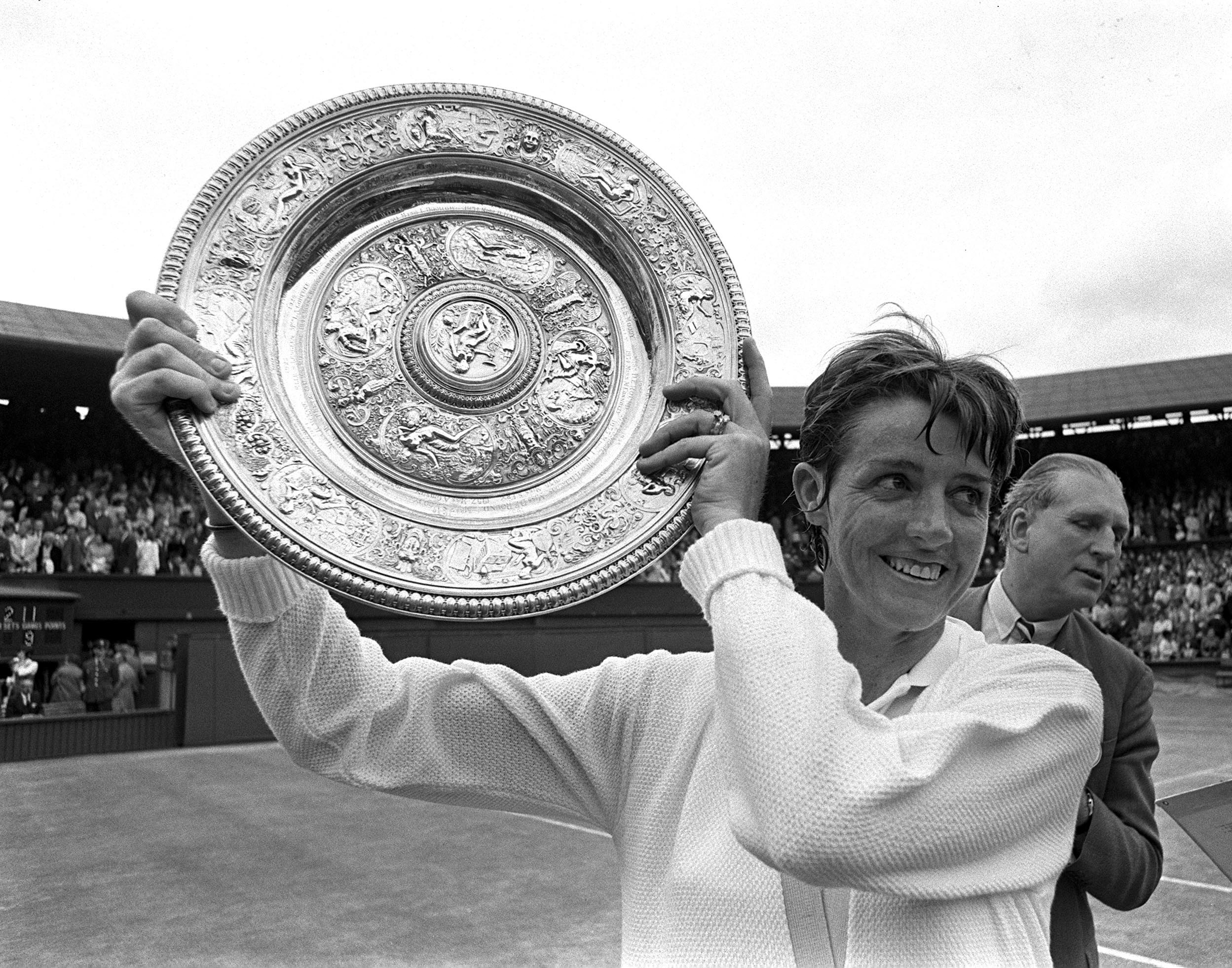 Margaret Court holds up the Ladies Singles plate at Wimbledon, July 3, 1970.