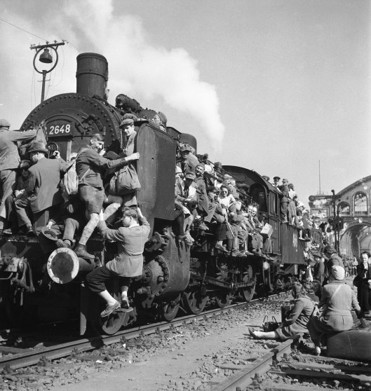 GERMANY - JUNE 06: Post WWII German refugees and displaced persons crowding every square inch of a train leaving Berlin. 1945.