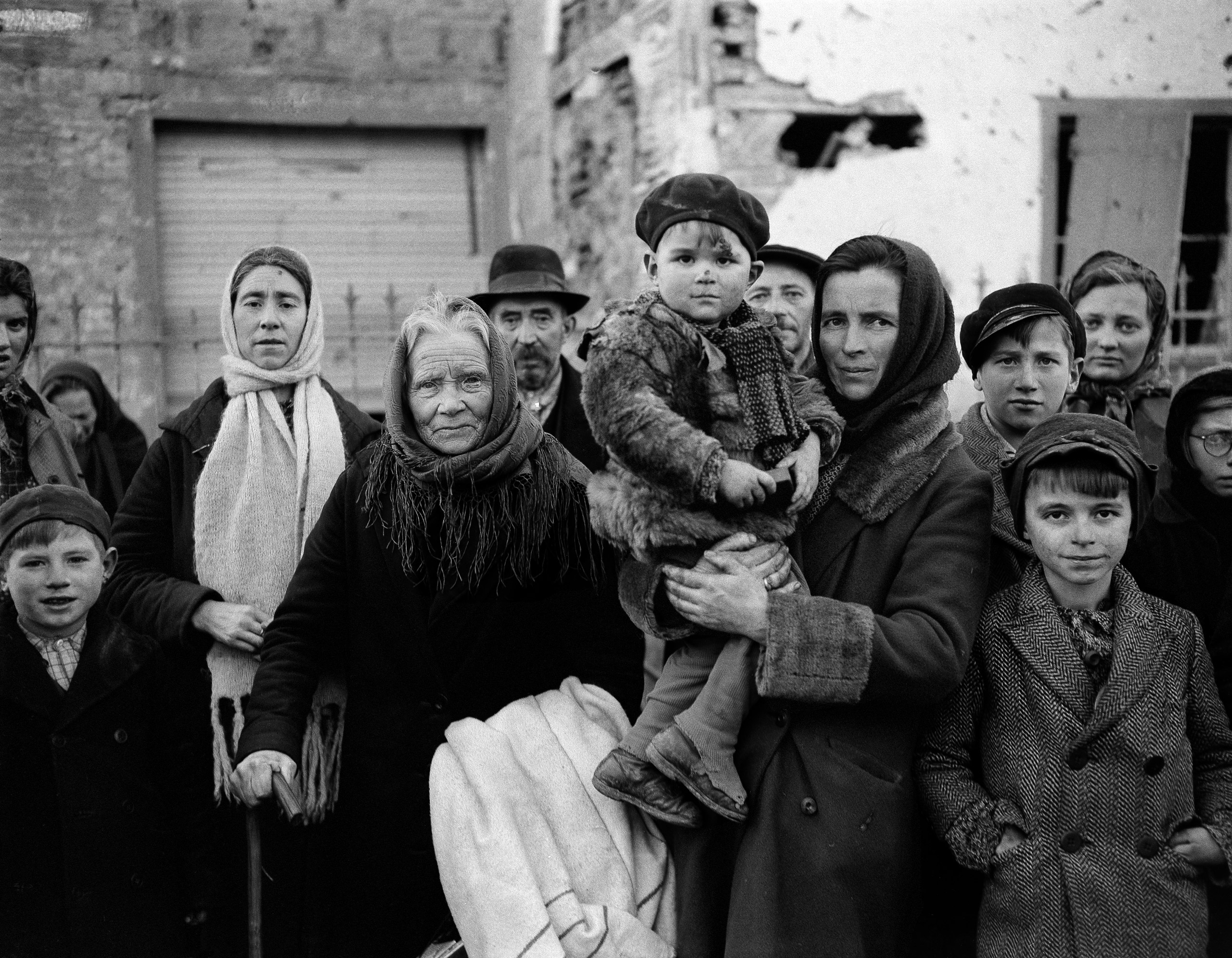 Refugees in La Gleize, Belgium, on Jan. 2, 1945, wait to be transported from the war-torn town after its recapture by American forces during the German thrust into the Belgium-Luxembourg salient.