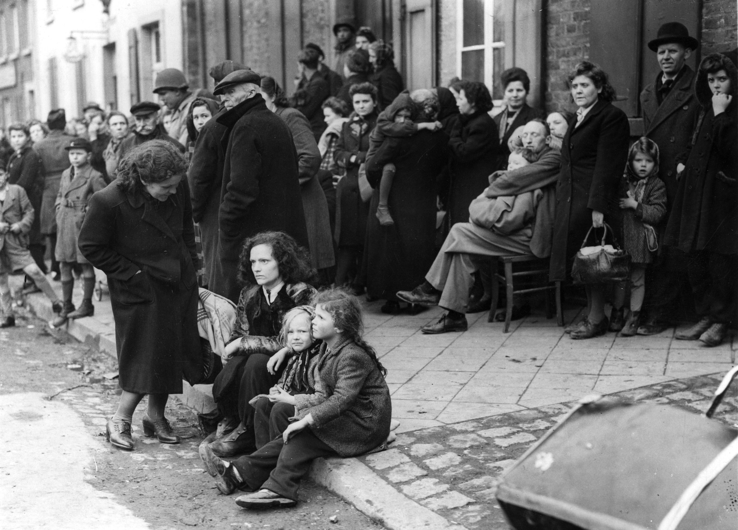 German refugees crowding the market square on Mar. 3, 1945, at Juchen, Germany, a town captured by the U.S. Army at the end of the Second World War.