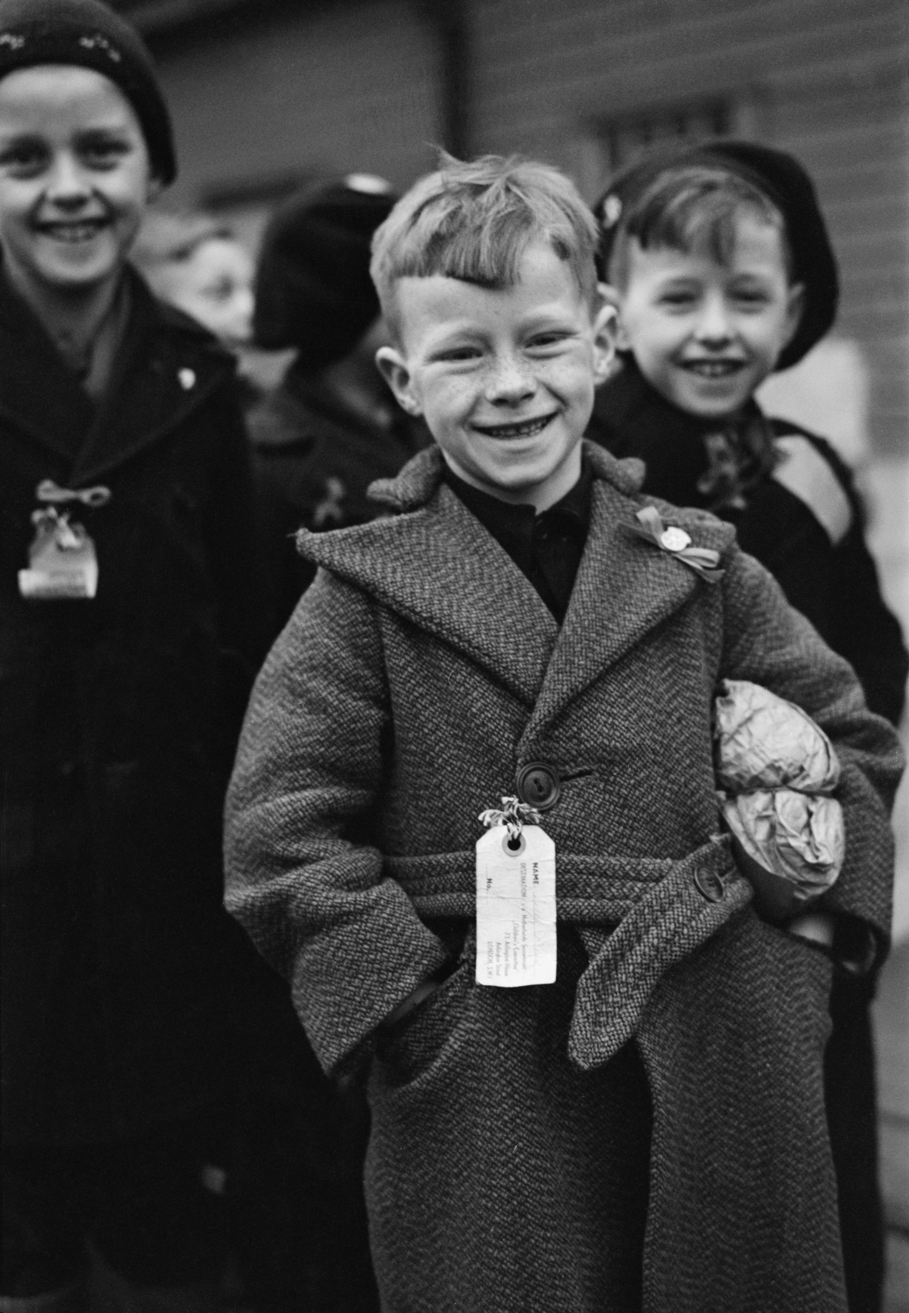 Dutch child refugees arrival In Britain at Tilbury, Essex, on Mar. 11, 1945. The small paper parcel under the boy's arm contains all his luggage.