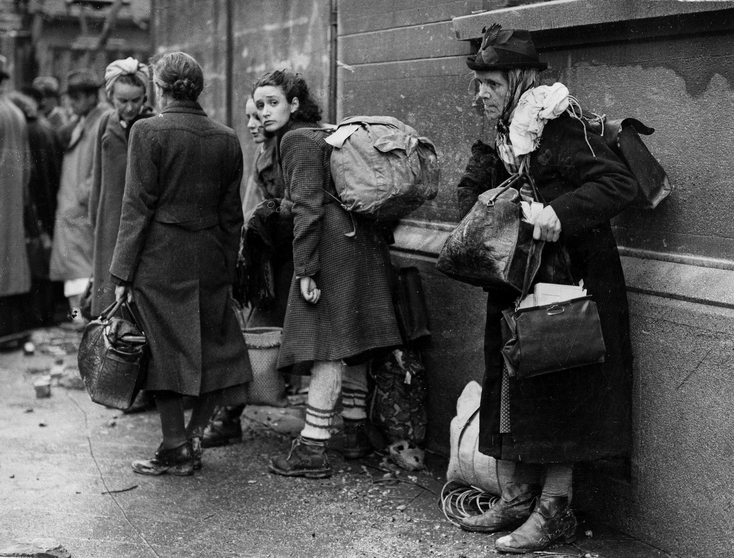 German civilian refugees prepare to flee war-torn Aachen, Germany as the battle for the doomed city draws to a close, Oct. 24, 1944.