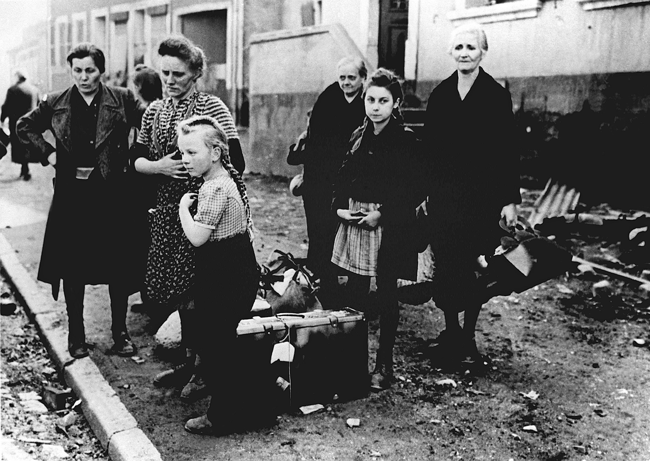 Women and children  standing at the roadside in 1945.