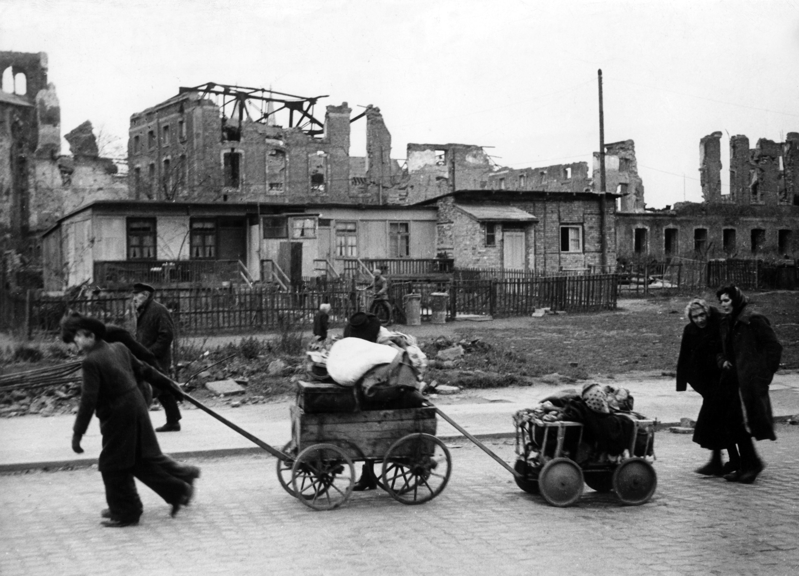 War refugees walking through Berlin with their belongings on Dec. 15, 1945.