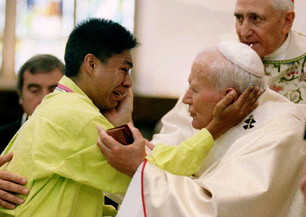 Frank Rocha of Amarillo, Tex., weeps as he is blessed by Pope John Paul II at Denver's Cathedral of the Immaculate Conception on Aug. 14, 1993.