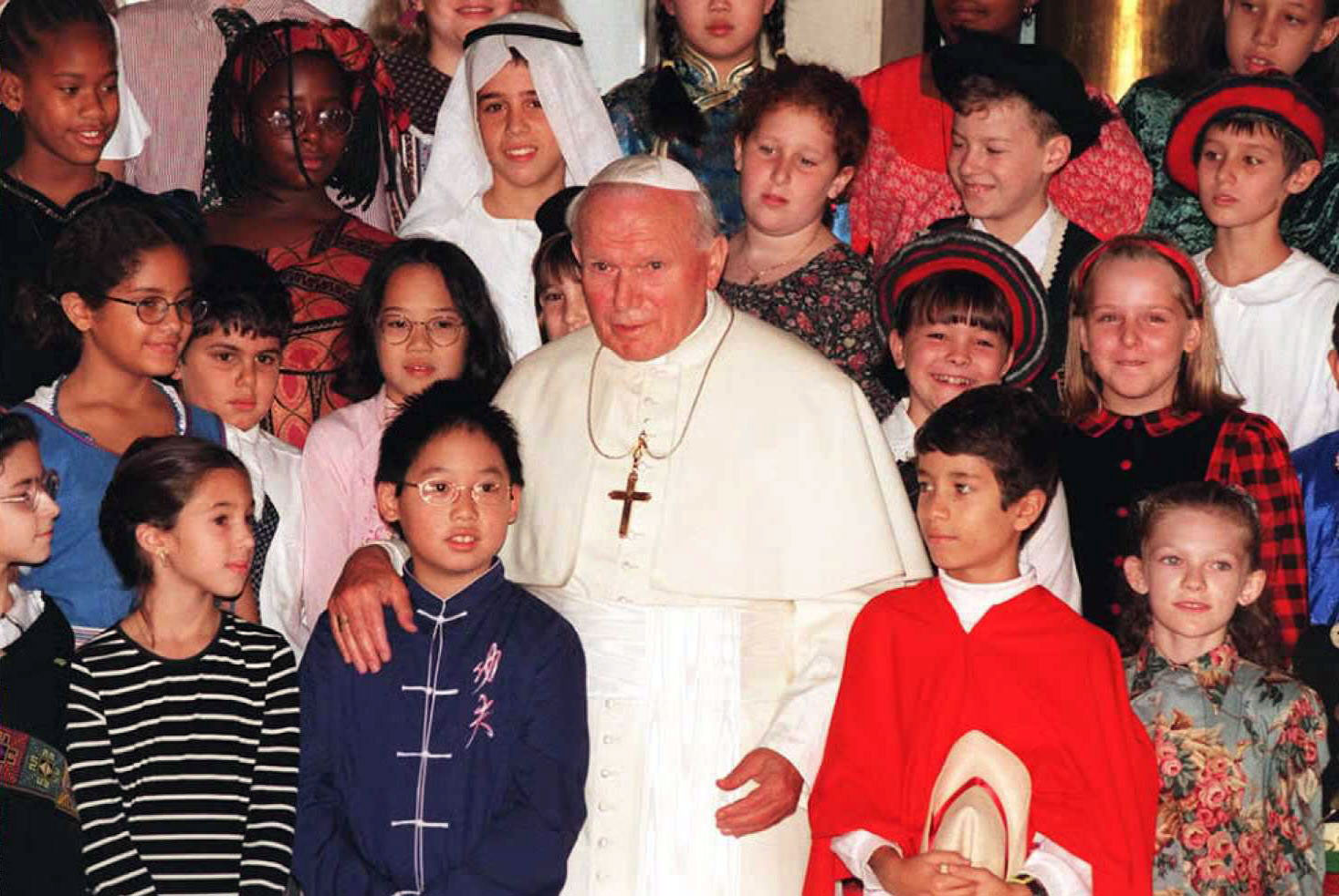 Pope John Paul II  with members of the United Nations International School choir during his visit to the UN in New York, Oct. 5, 1995.