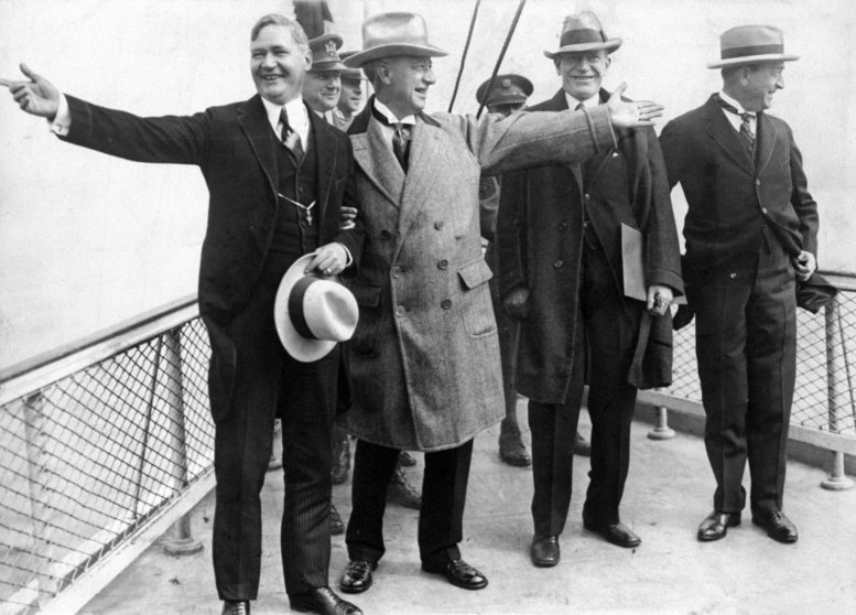 "Governors A. Harry Moore and Al Smith pointing to their respective shores as they ""break ground"" for the new $60,000,000 dollar bridge. September 22, 1927."