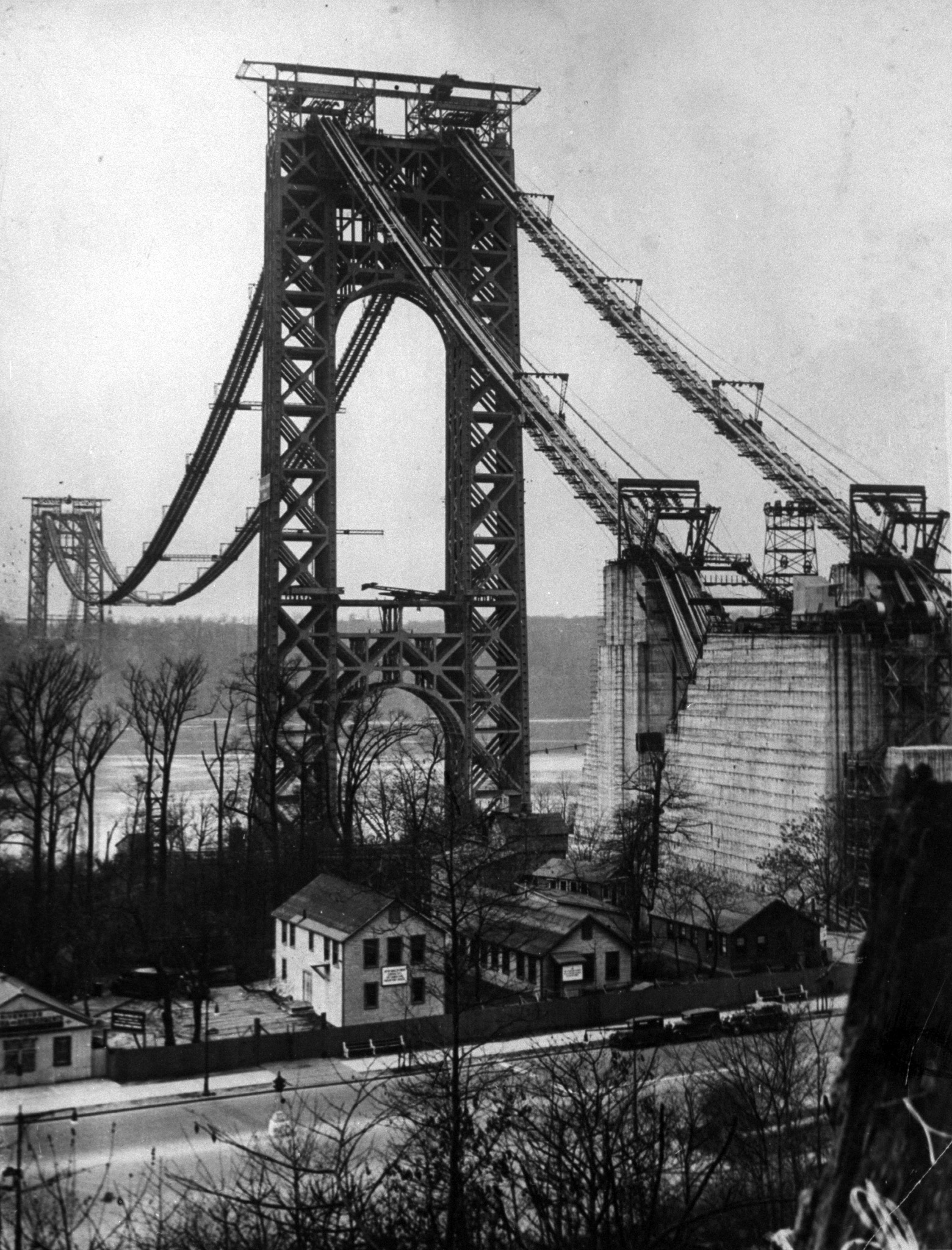 Main towers and cables of the George Washington Bridge under construction that linked New York to New Jersey when it opened, the longest suspension bridge in the world.  1929.