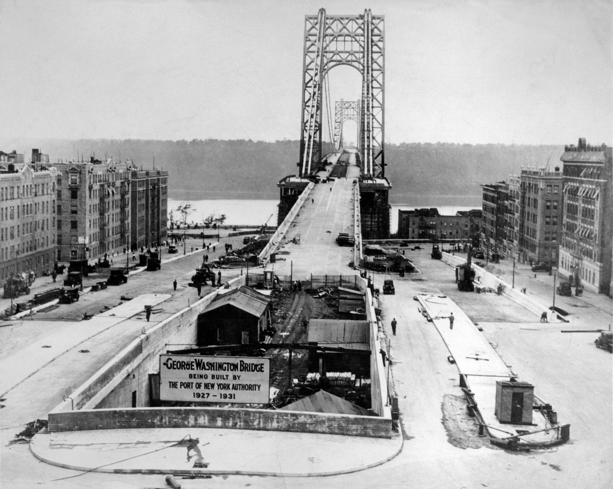 A view of the structure from the New York end, showing the underground approach as well as the one on the surface and the exit. That's New Jersey over in the distance. Oct. 19, 1931.