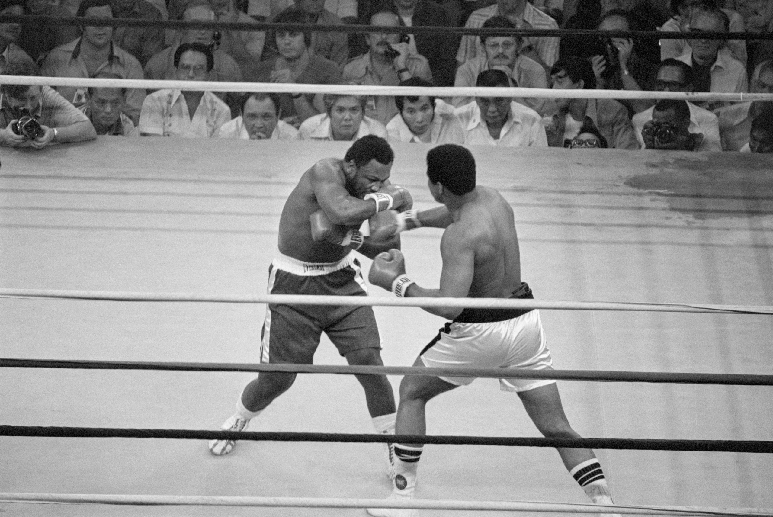 Oct. 1, 1975, Manila, —Heavyweight champion Muhammad Ali punches Joe Frazier during their title bout in Manila in 1975.