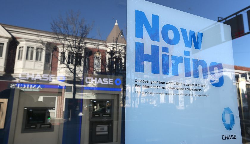 A 'now hiring' sign in the window of a Chase bank branch in San Rafael, Calif.