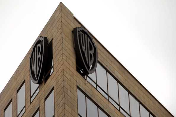 The Warner Bros. logo is displayed on a building at Warner Bros. Studios in Burbank, California, U.S., on Tuesday, Feb. 5, 2013. Warner Bros. announced on Sunday that the company is entering into a joint venture with China Media Capital to create Chinese-language films for a global audience.
