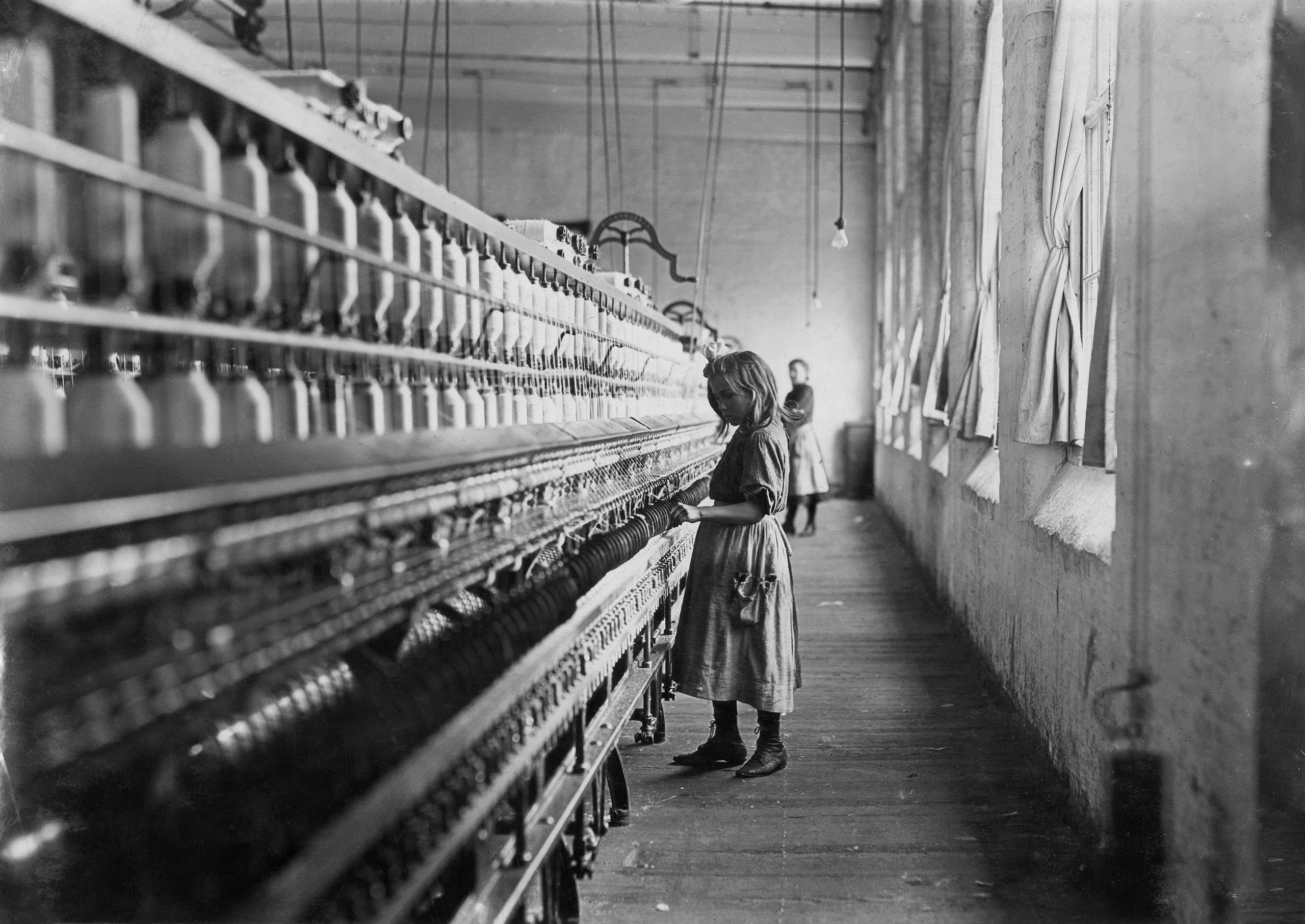 Girl Worker in Carolina Cotton Mill by Lewis Hine, 1908.