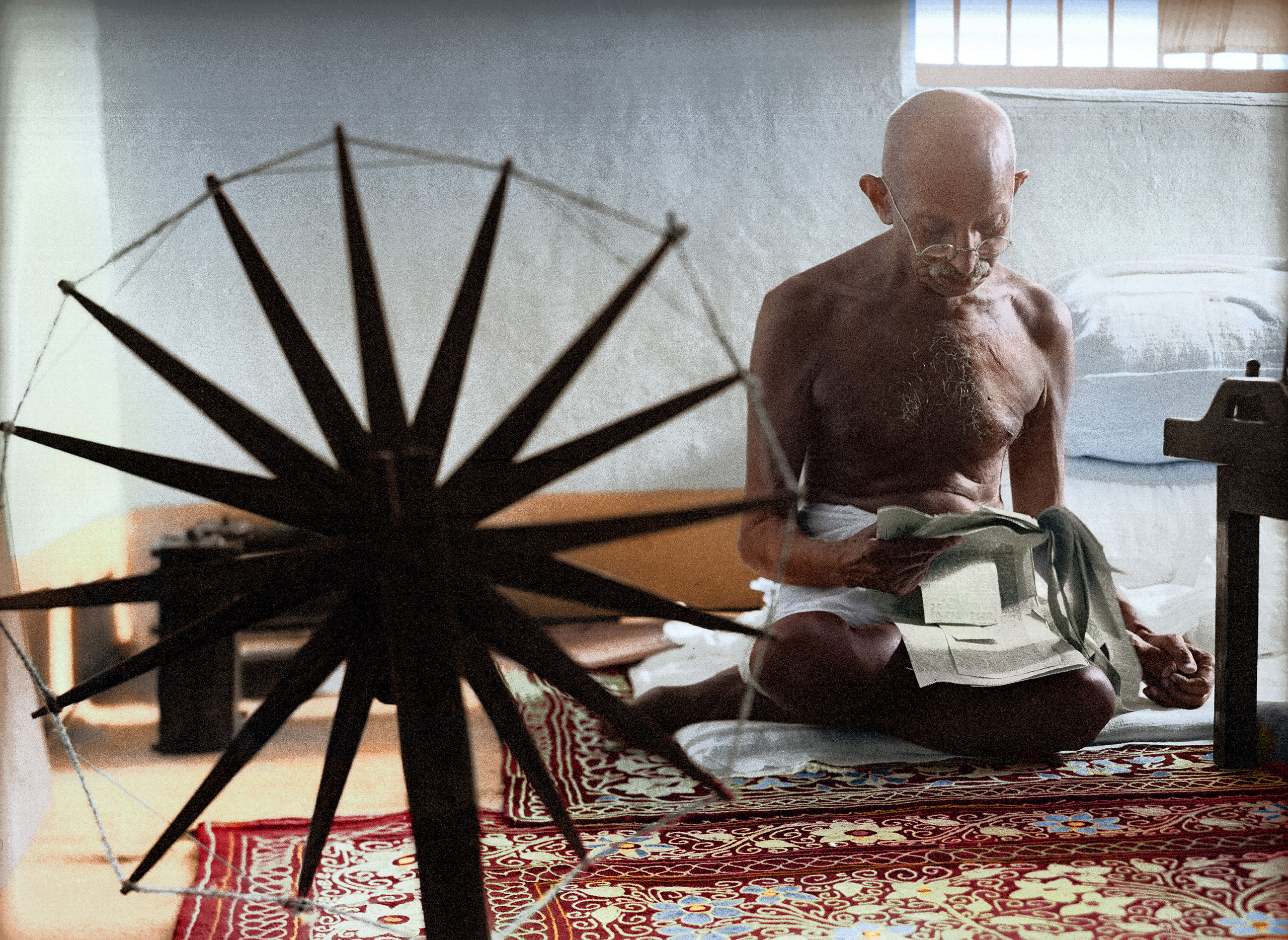Gandhi and the Spinning Wheel by Margaret Bourke-White, 1946.