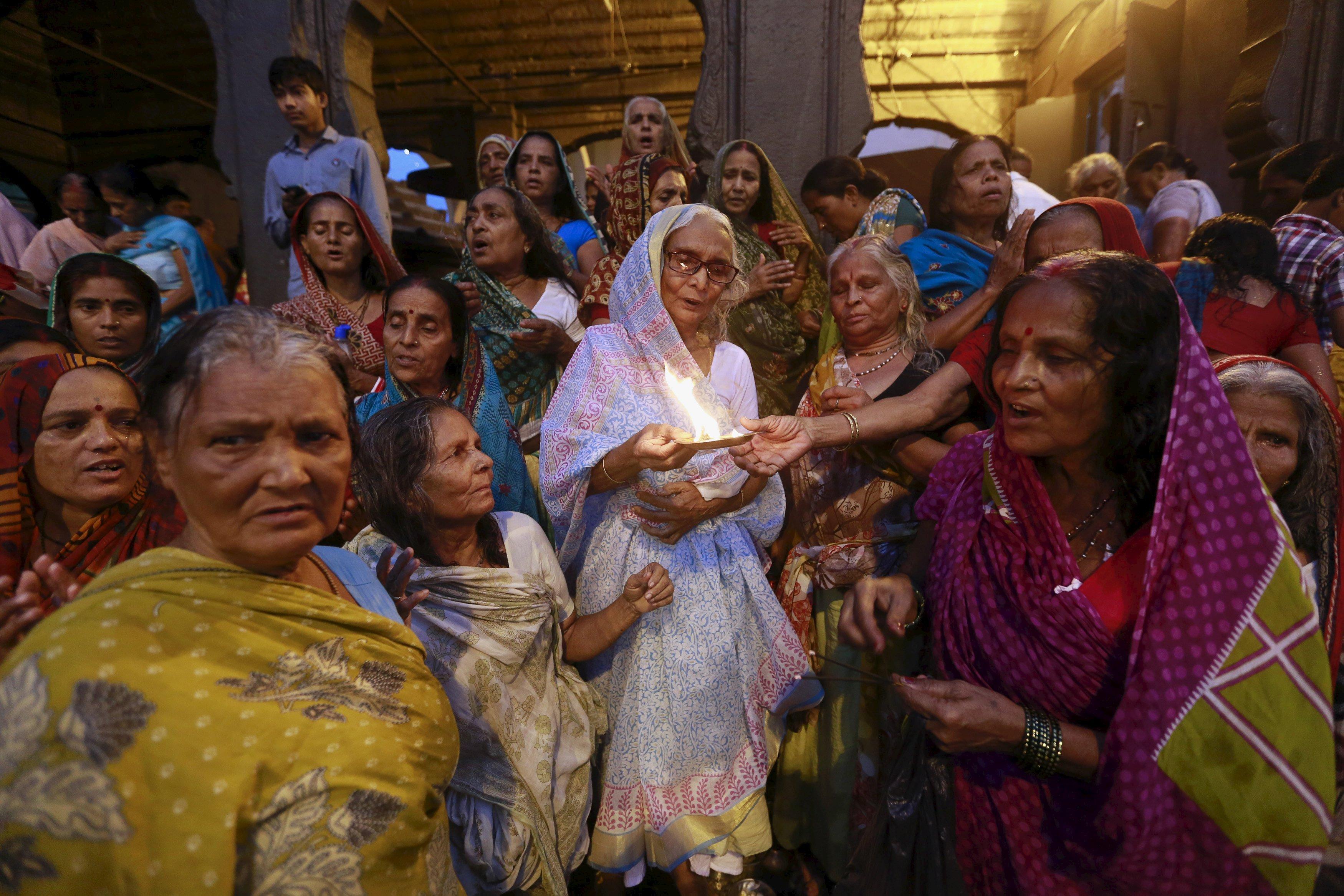 Hindu devotees pray on the banks of Godavari river during Kumbh Mela Festival in Nashik, India, on Aug. 28, 2015.