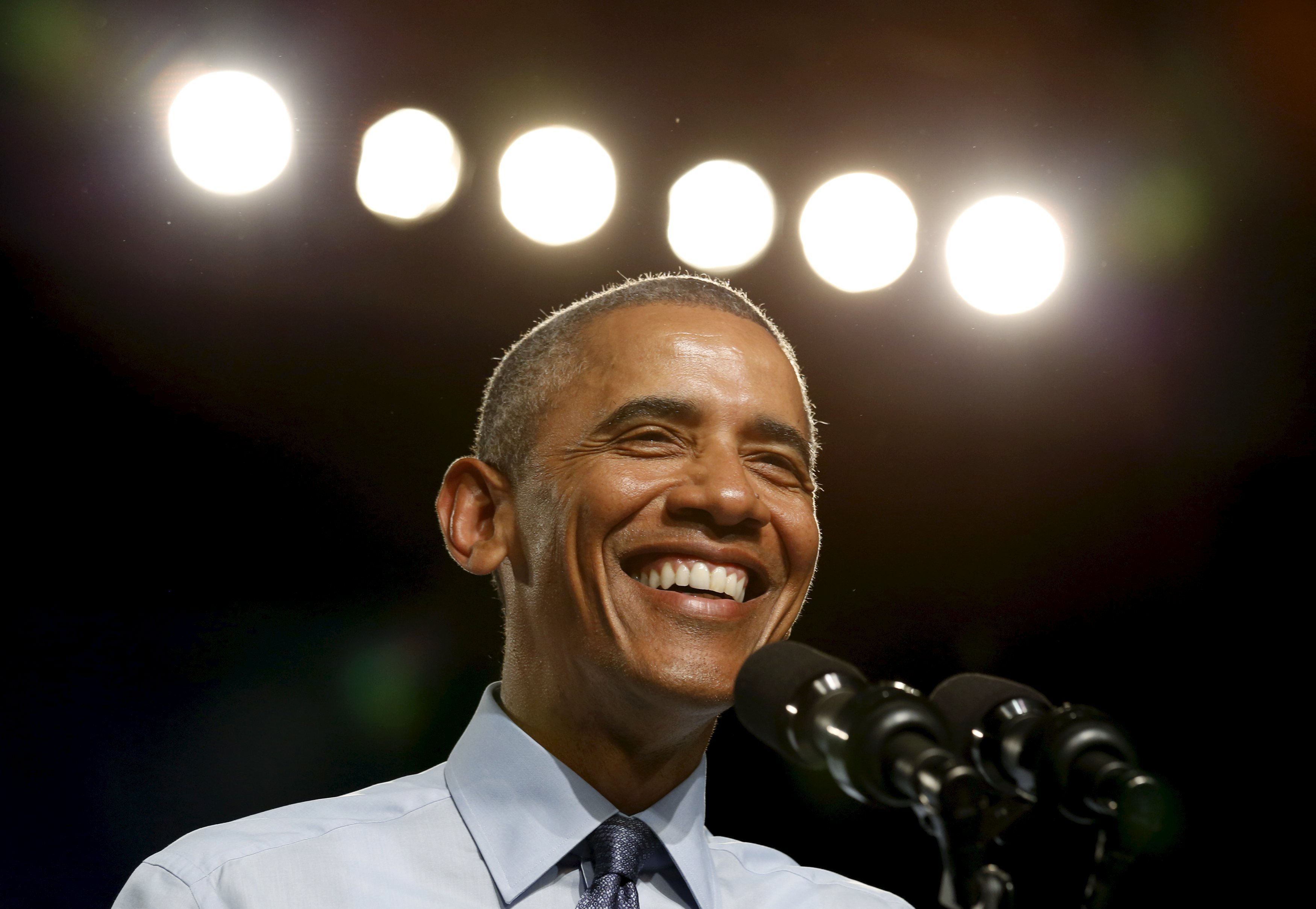 U.S. President Barack Obama smiles while speaking during a visit to Macomb Community College in Warren, Michigan on Sept. 9, 2015.