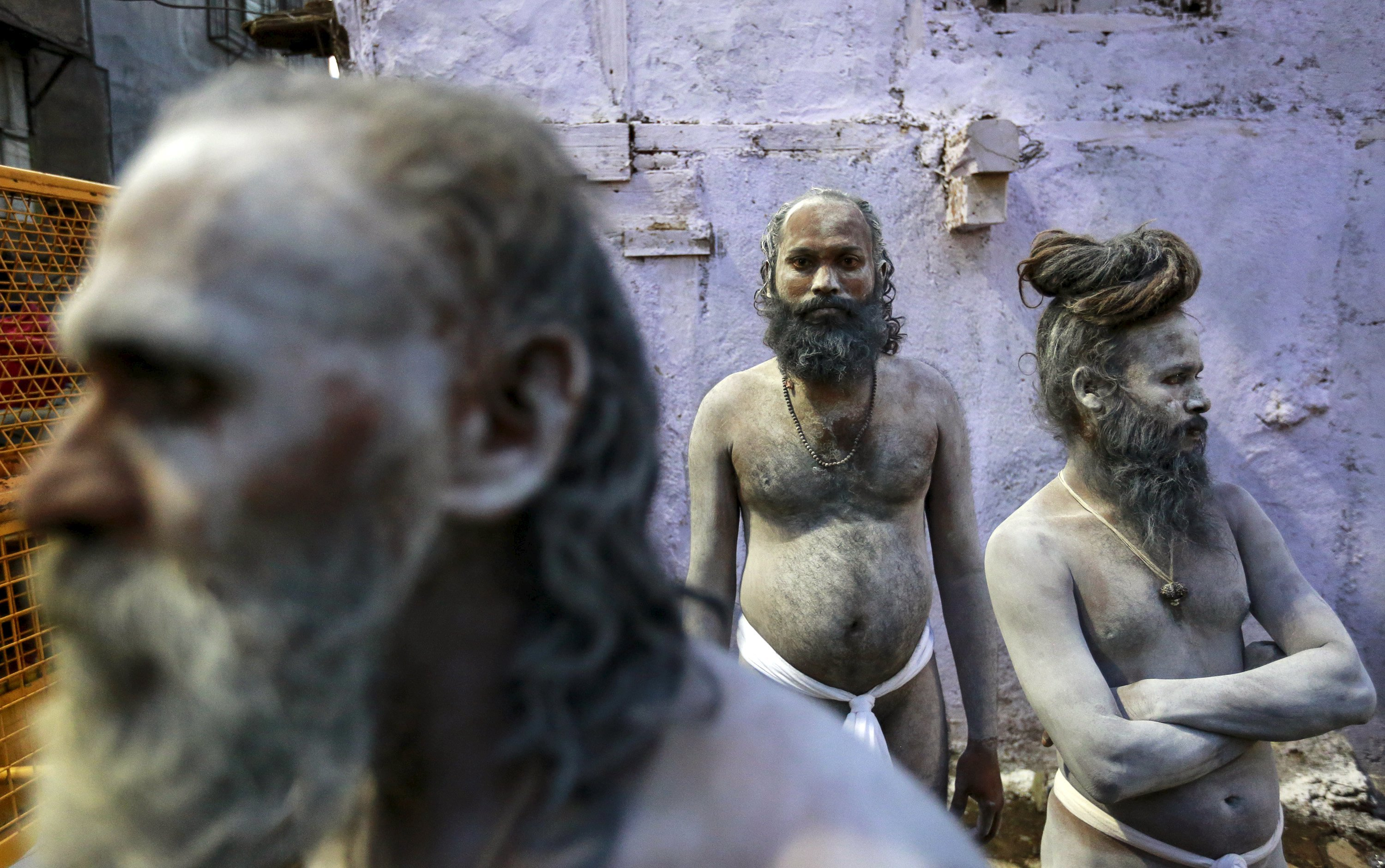 Naga Sadhus, or Hindu holy men, wait during a procession before taking a dip in a holy pond during the second  Shahi Snan  (grand bath) at Kumbh Mela in Trimbakeshwar, India, on Sept. 13, 2015.