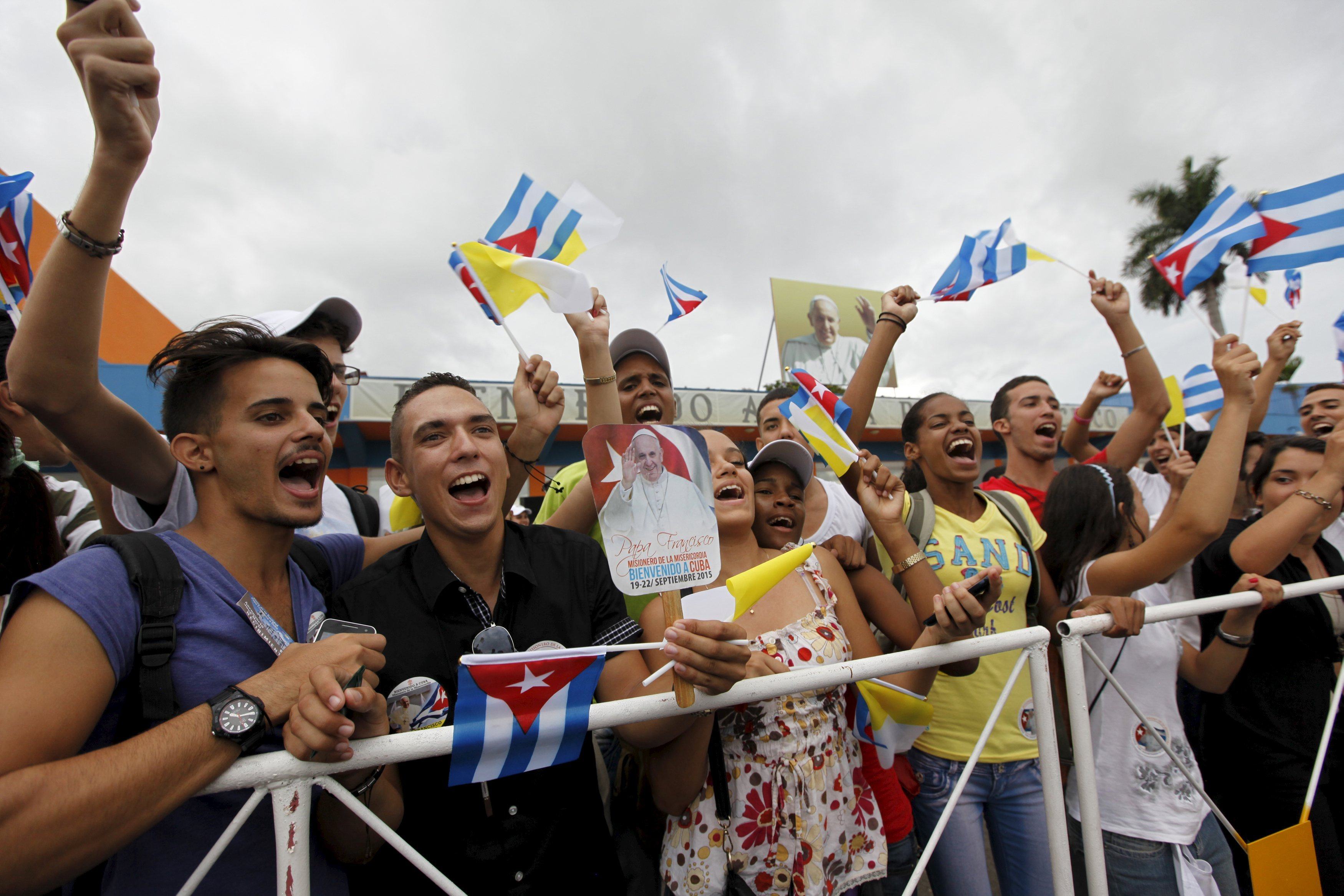 People react after the arrival of Pope Francis outside the airport in Havana, on Sept. 19, 2015.