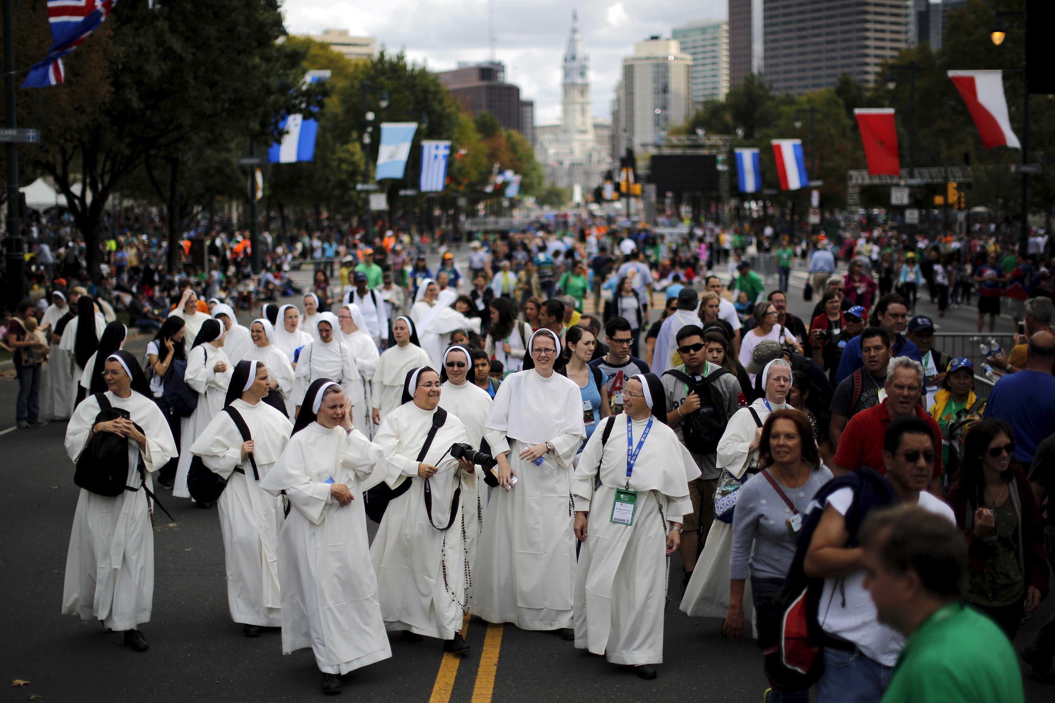 Nuns wait for Pope Francis' arrival at the Festival of Families rally along Benjamin Franklin Parkway in Philadelphia, on Sept. 26, 2015.