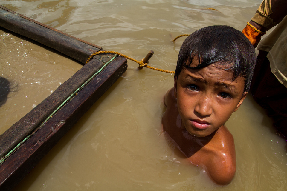 An 11-year-old boy works at an underwater mining site in Camarines Norte province, Philippines.