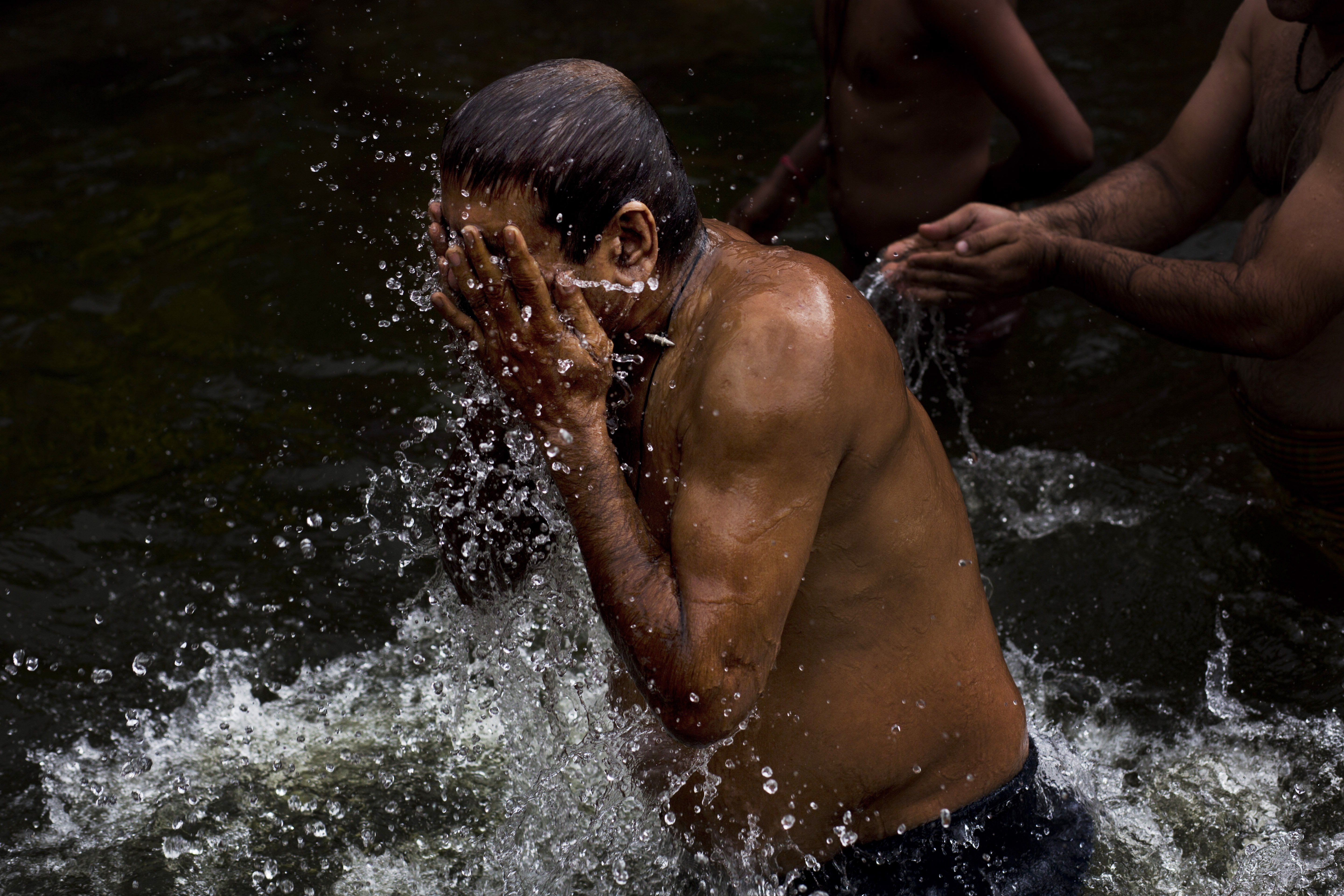 Hindu devotees perform a holy dip in the Godavari River during Kumbh Mela, or Pitcher Festival, in Nasik, India, on Aug. 26, 2015
