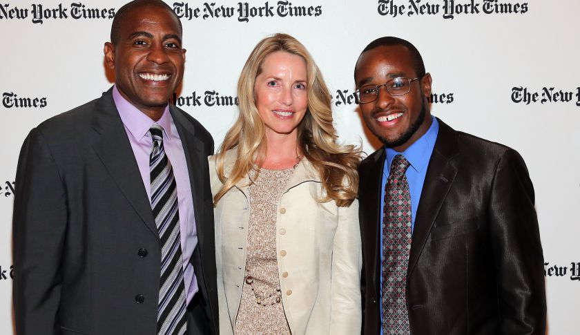 Laurene Powell Jobs, center, has committed $50 million to create new high schools. She is seen here at an event in New York in September 2014.