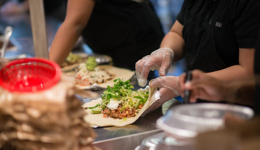 Employees prepare lunch orders at a Chipotle Mexican Grill restaurant in New York.