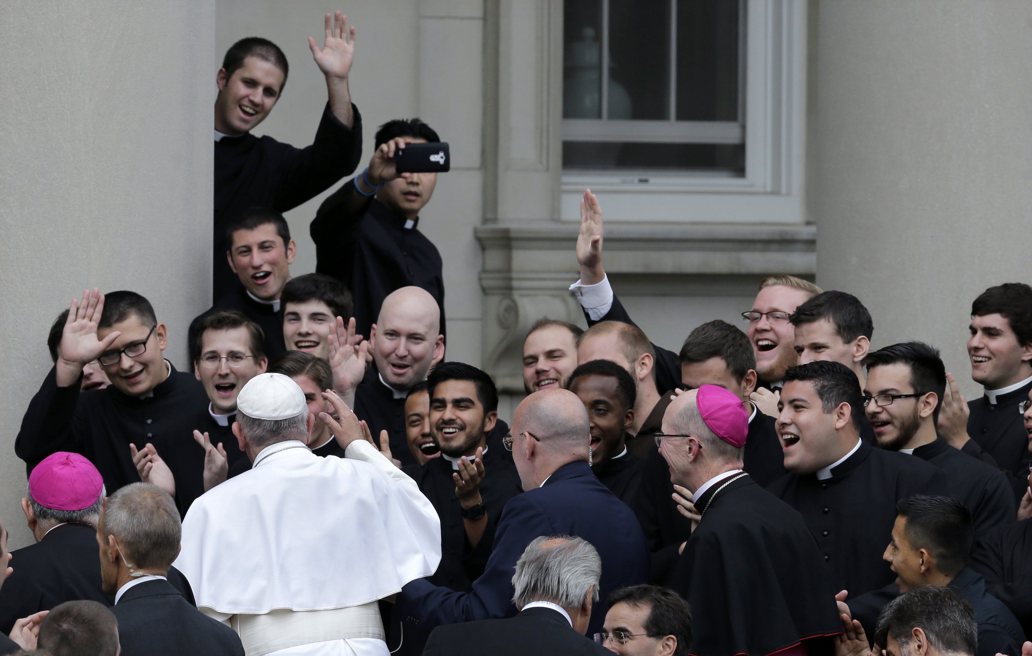 Pope Francis is greeted by seminarians as he arrives at St. Charles Borromeo Seminary, on Sept. 26, 2015, in Wynnewood, Pa.