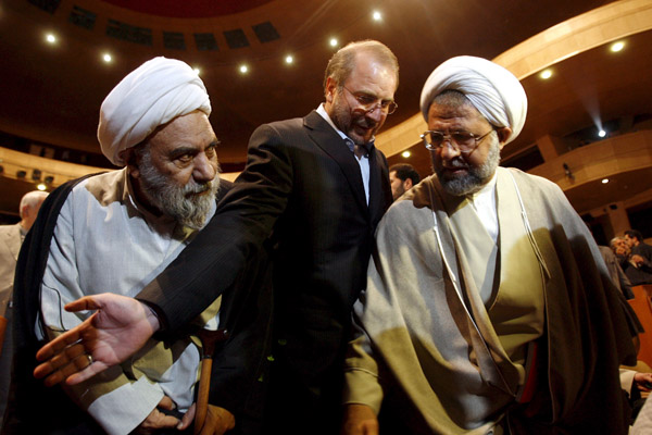 Tehran Mayor Mohammed-Baqer Qalibaf, center, attends the Milad Tower's opening ceremony in Tehran on Oct. 07, 2008