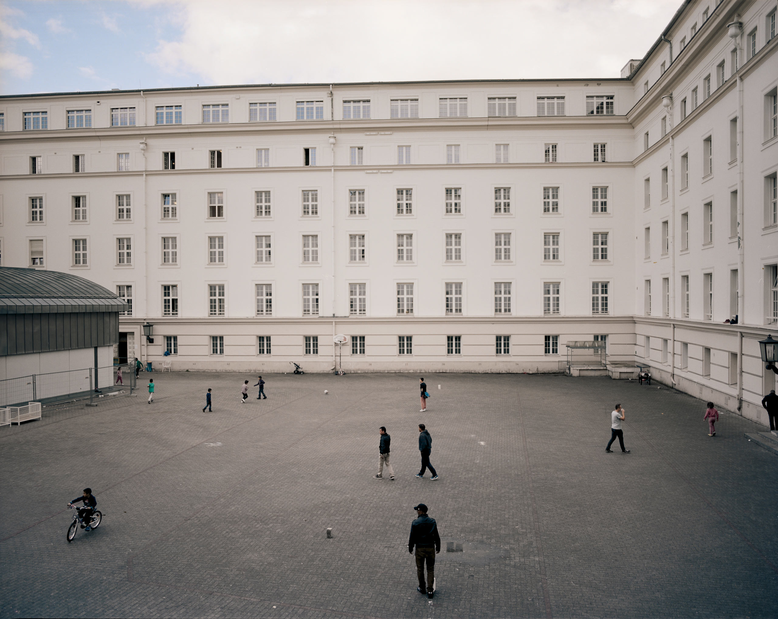 Children play in the courtyard of the former city hall in the district of Wilmersdorf, Berlin. Volunteers helped convert it into a reception center for refugees in mid-August.