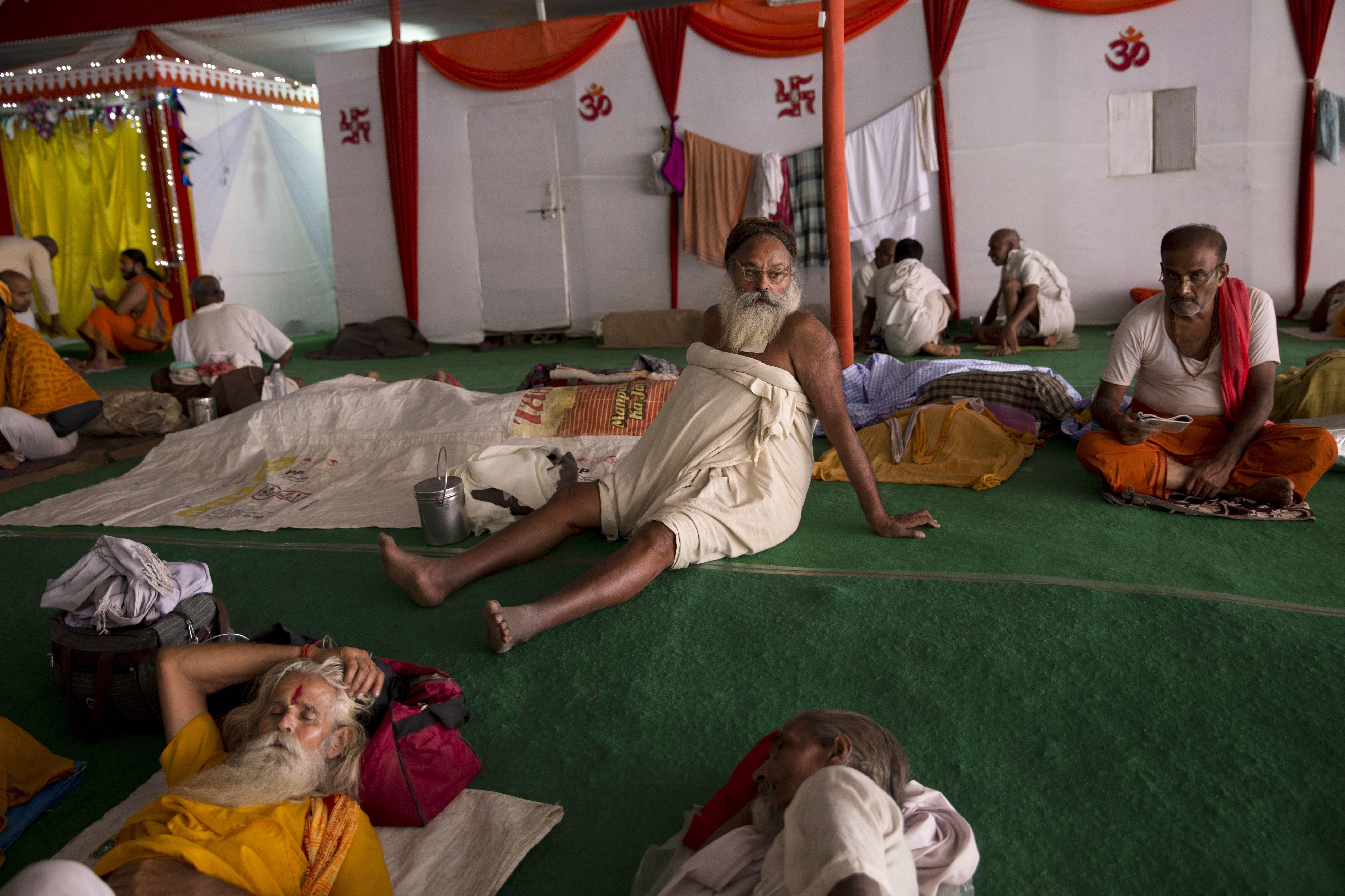 Hindu holy men take rest at a make shift shelter during Kumbh Mela in Nashik, India, on Aug. 27, 2015.