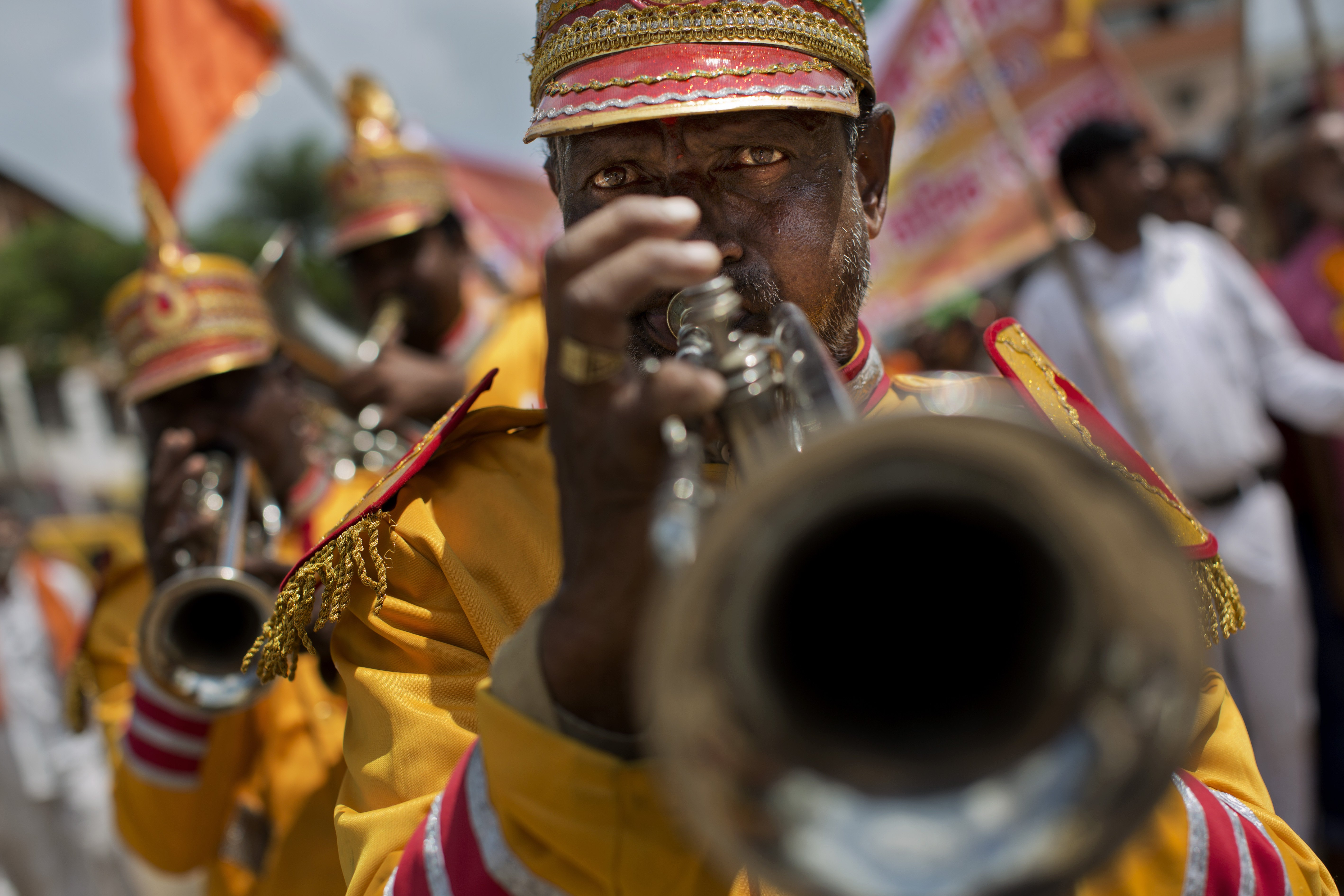 Members of an Indian brass band perform in a procession during Kumbh Mela, or Pitcher Festival, at Trimbakeshwar, India, on Aug. 27, 2015.