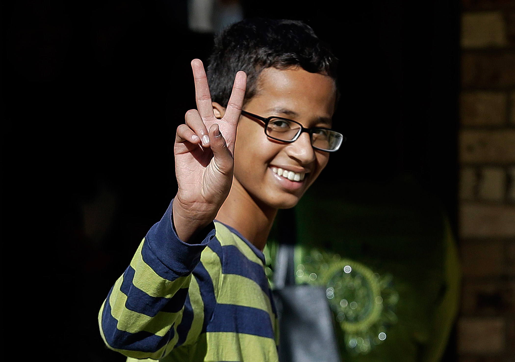 Ahmed Mohamed, 14, gestures as he arrives to his family's home on Sept. 17, 2015 in Irving, Texas.