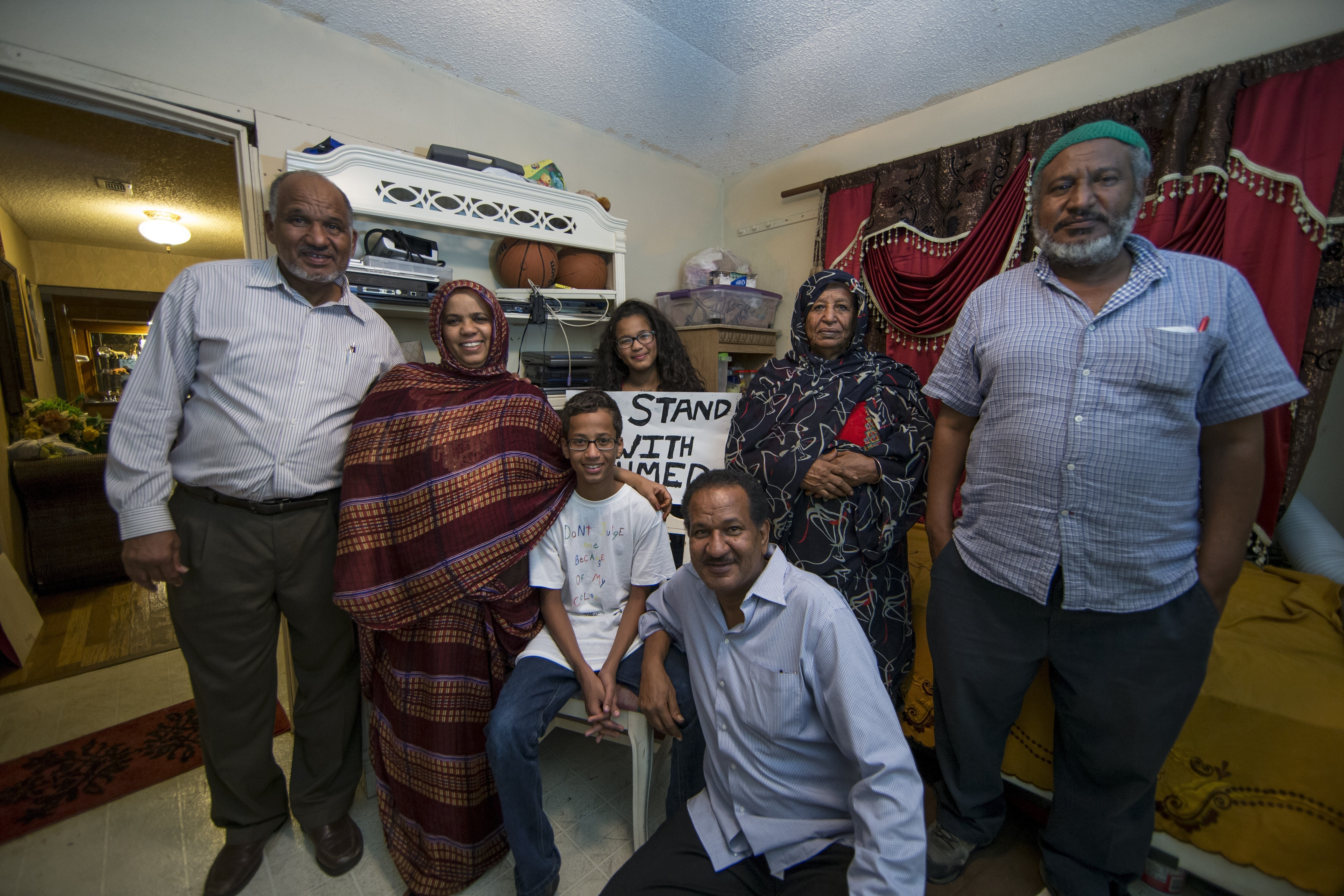 Ahmed Mohamed (L 3), a Texas Muslim teen arrested after taking his homemade clock to school, poses next to his family members at his house in Irving, Texas on Sept. 17, 2015.