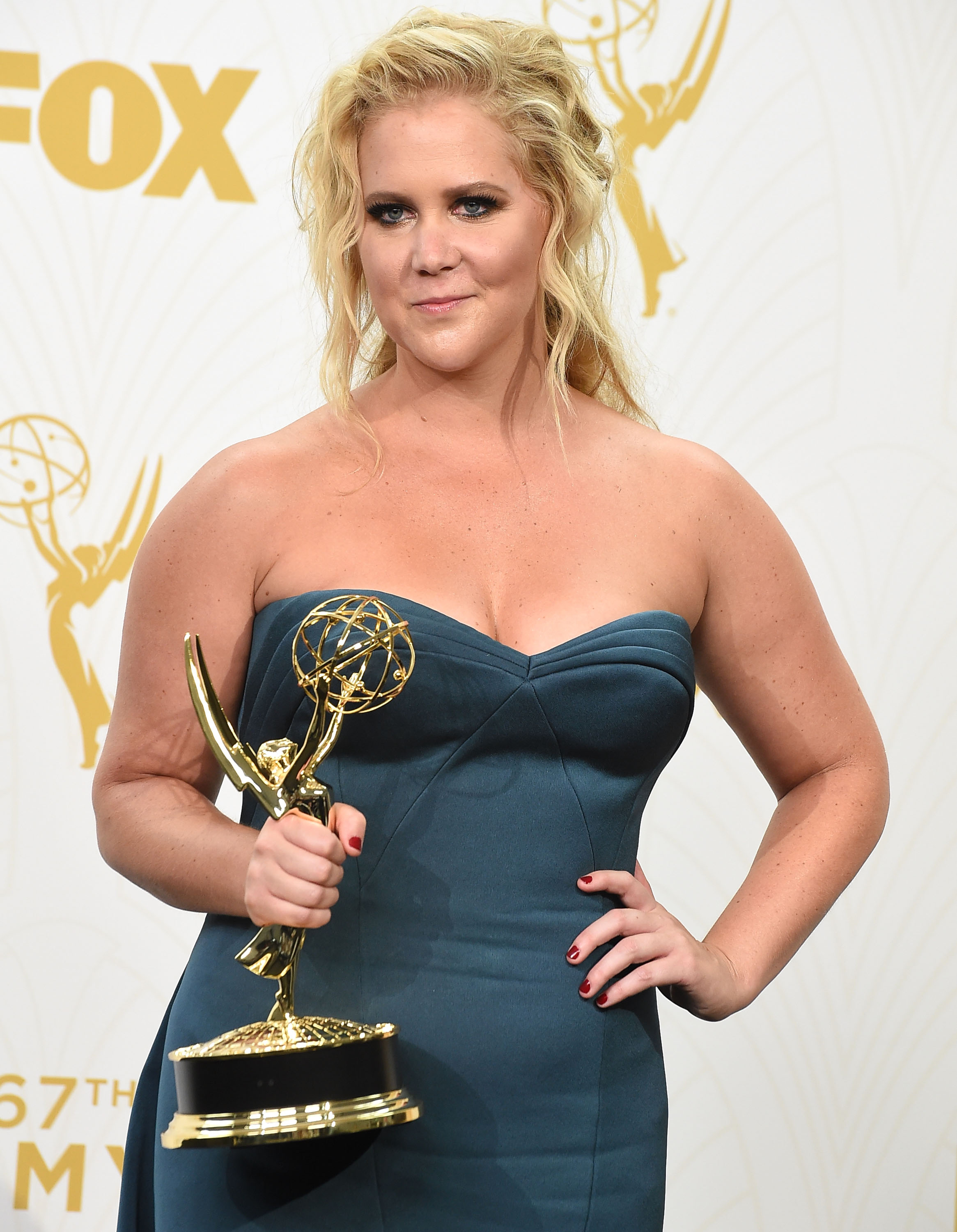 Amy Schumer poses at the 67th Annual Primetime Emmy Awards at Microsoft Theater on September 20, 2015 in Los Angeles, California.