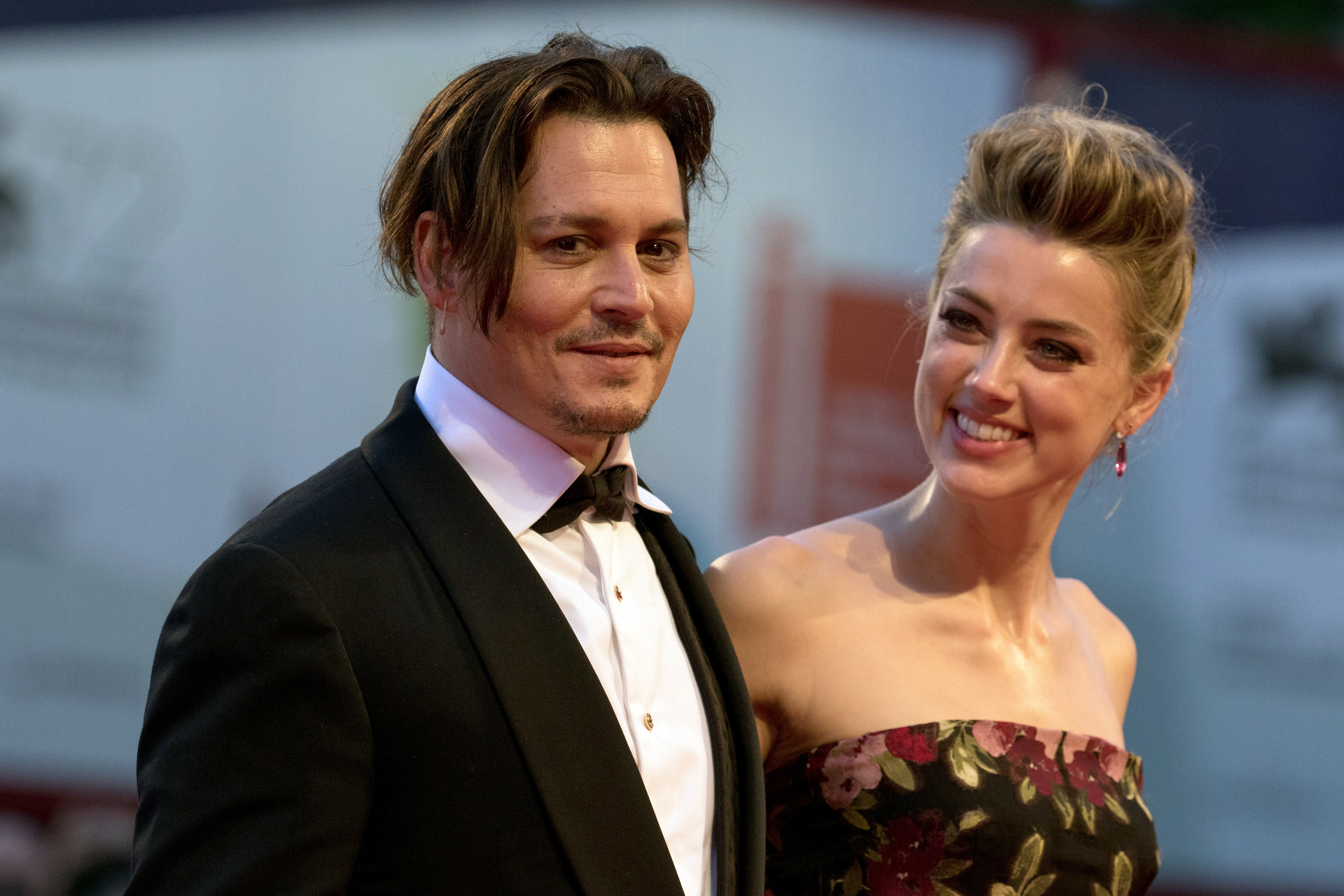Actors Johnny Depp and Amber Heard attend the premiere of The Danish Girl during the 72nd Venice Film Festival at Palazzo del Cinema in Venice on Sept. 5, 2015