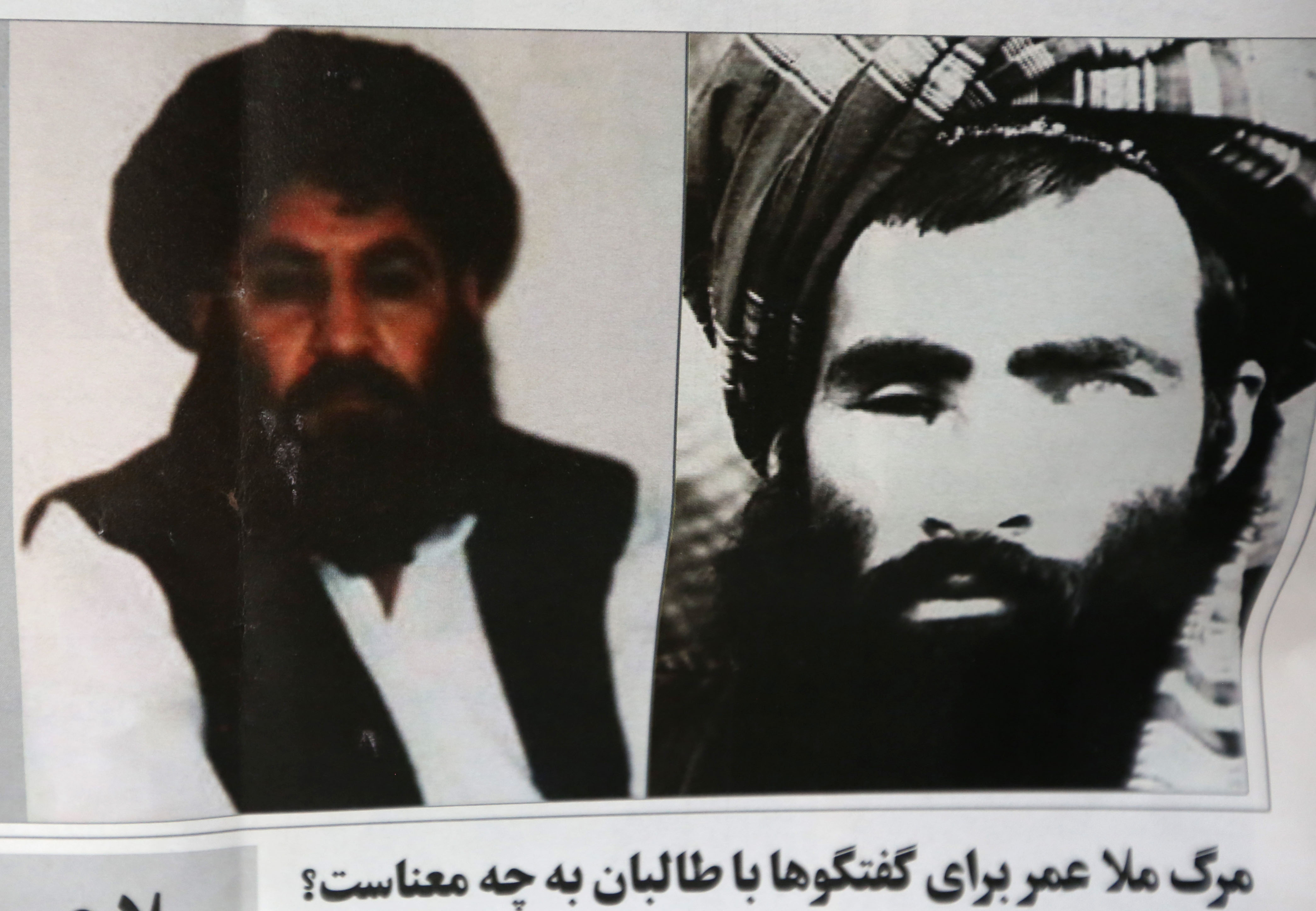 In this Aug. 1, 2015, file photo, an Afghan newspaper headlines pictures of the new leader of the Afghan Taliban, Mullah Akhtar Mansour, left, and former leader Mullah Omar, in Kabul