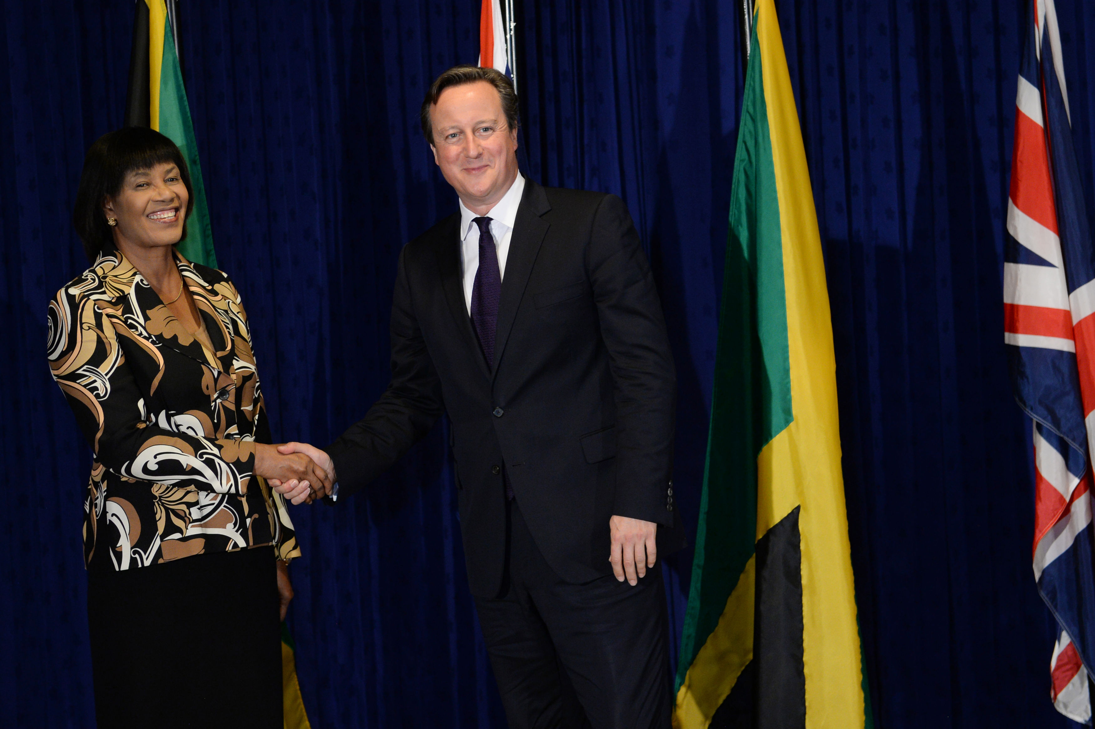 Prime Minister David Cameron is greeted by Jamaican Prime Minister Portia Simpson-Miller at her office, Jamaica House, in Kingston, on the first of a two day visit to the Caribbean on September 29, 2015