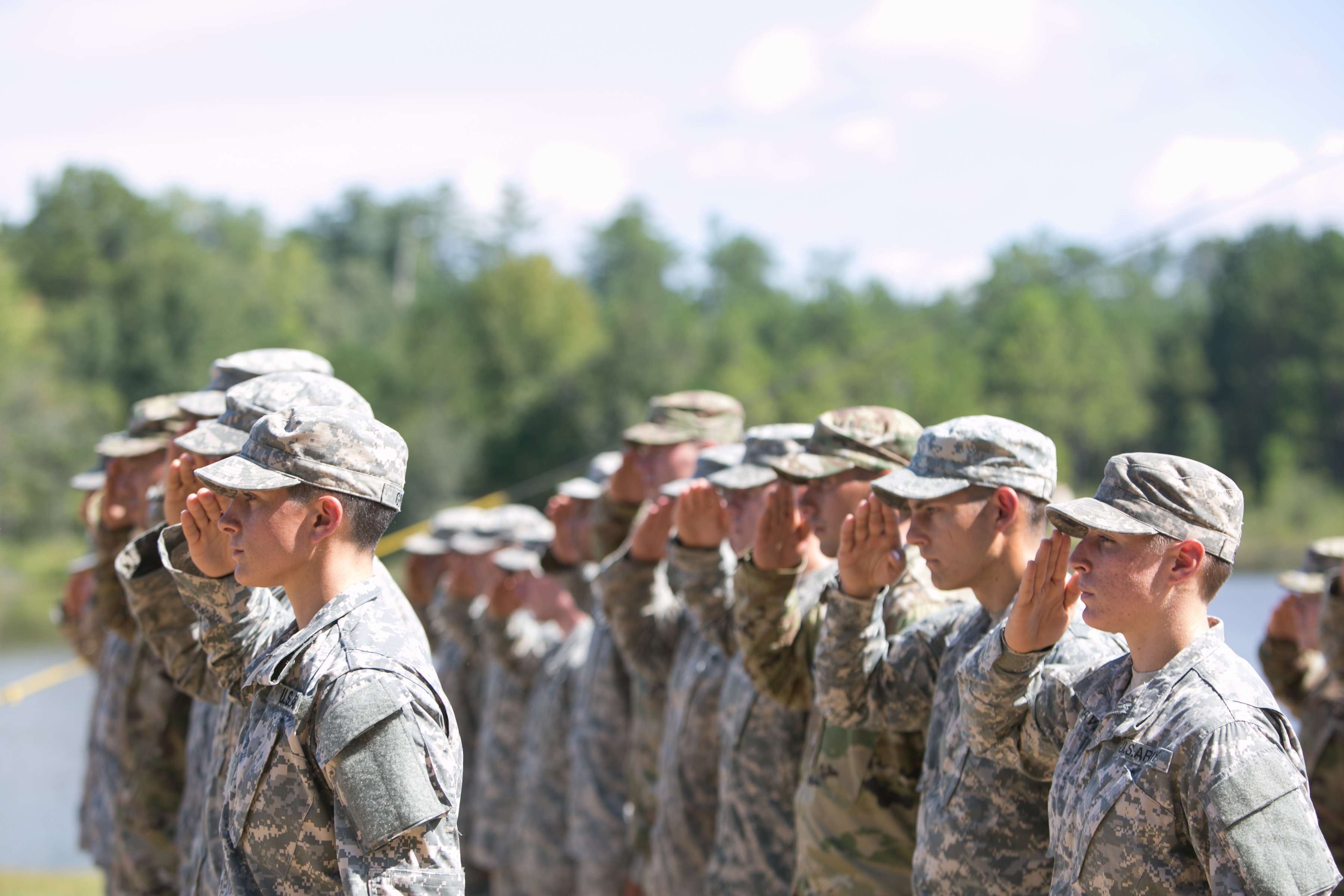 Capt. Kristen Griest (L) and 1st Lt.  Shaye Haver (R) salute during the graduation ceremony of the United States Army's Ranger School at Fort Benning, Georgia on Aug. 21, 2015.  Griest and Haver are the first females to graduate from the Army's intensive Ranger School.