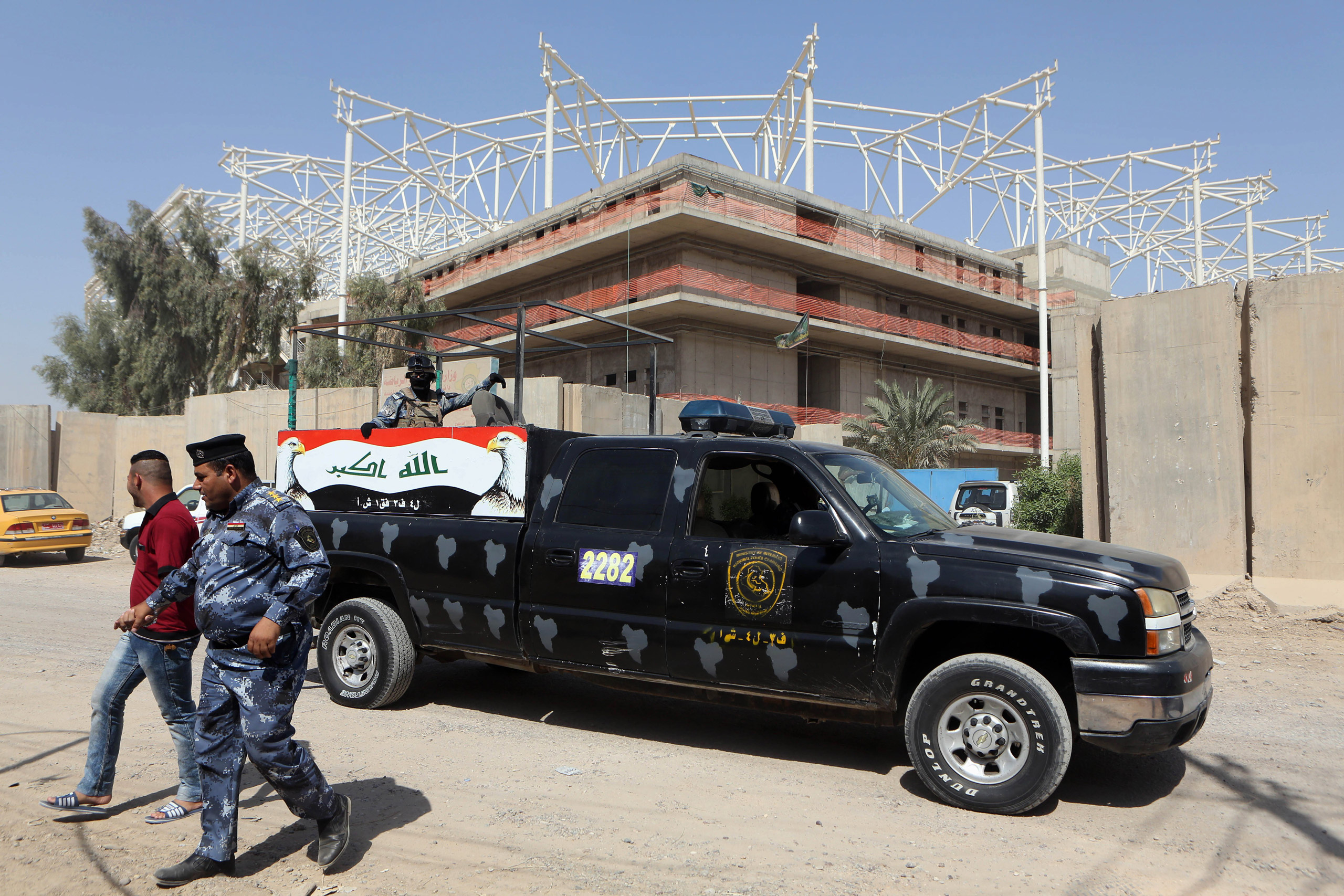Iraqi security forces guard the entrance to a sports complex where 18 Turkish workers were kidnapped by masked men in military uniforms, according to Iraqi security officials, in Baghdad, on Sept. 2, 2015.