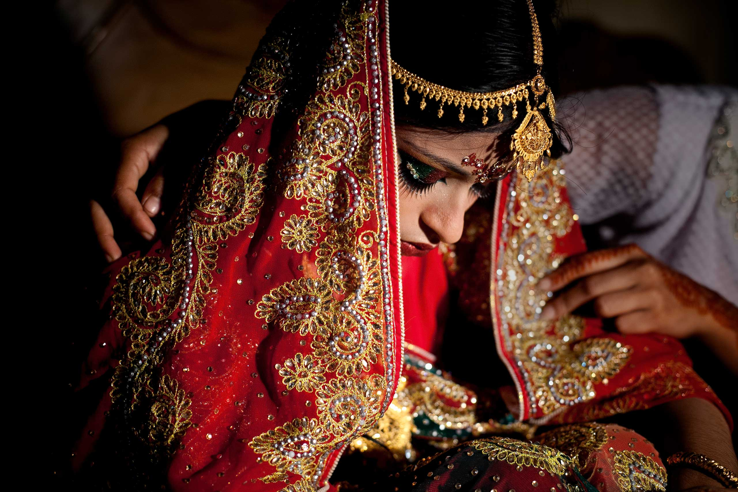 International Business Times: Child Marriage Bangladesh15 year old Nasoin Akhter is consoled by a friend on the day of her wedding to a 32 year old man, in Manikganj, Bangladesh, on Aug. 20, 2015.