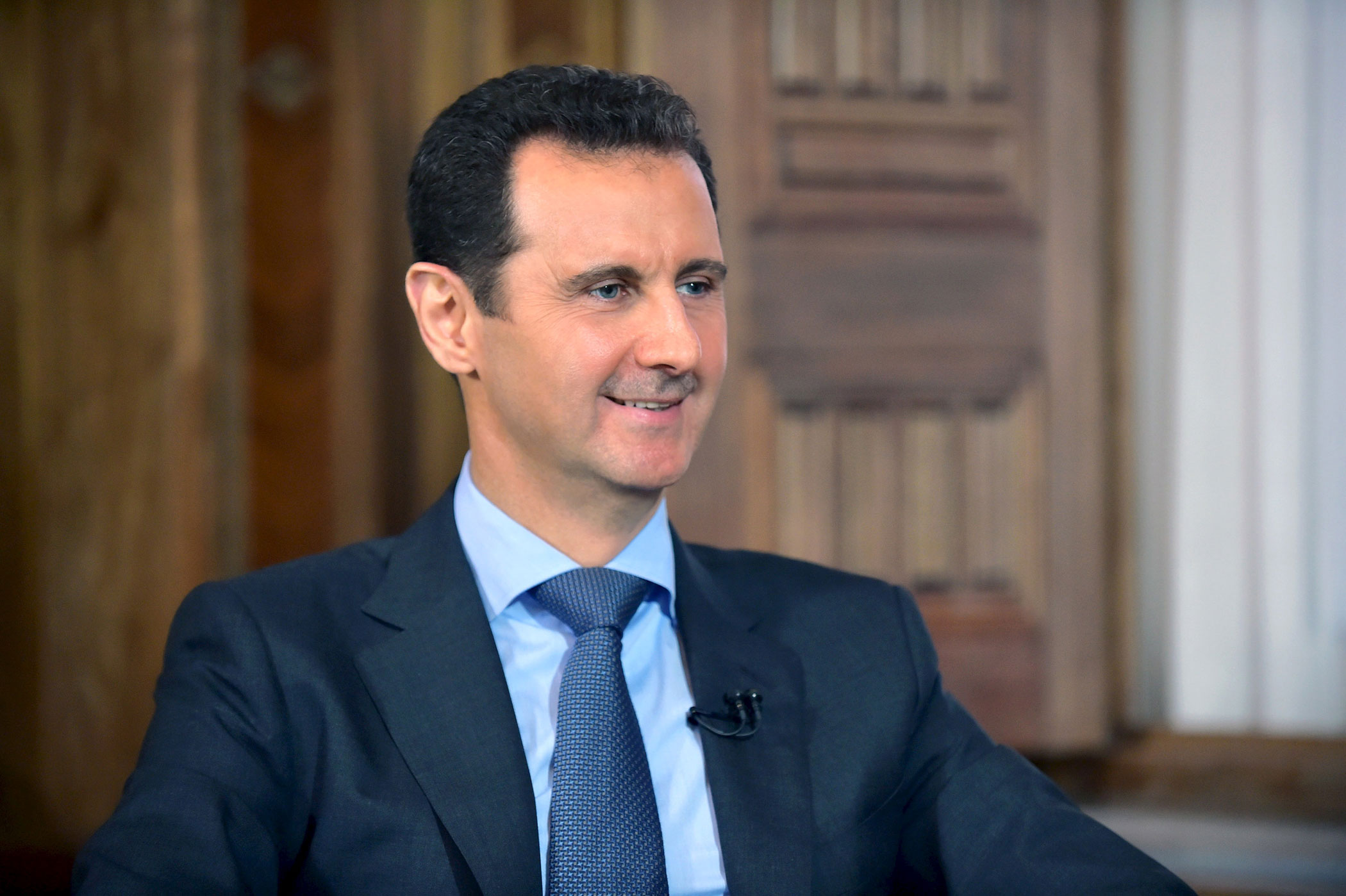 Syria's President Bashar al-Assad answers questions during an interview with al-Manar's journalist Amro Nassef on Aug. 25, 2015 in Damascus, Syria.