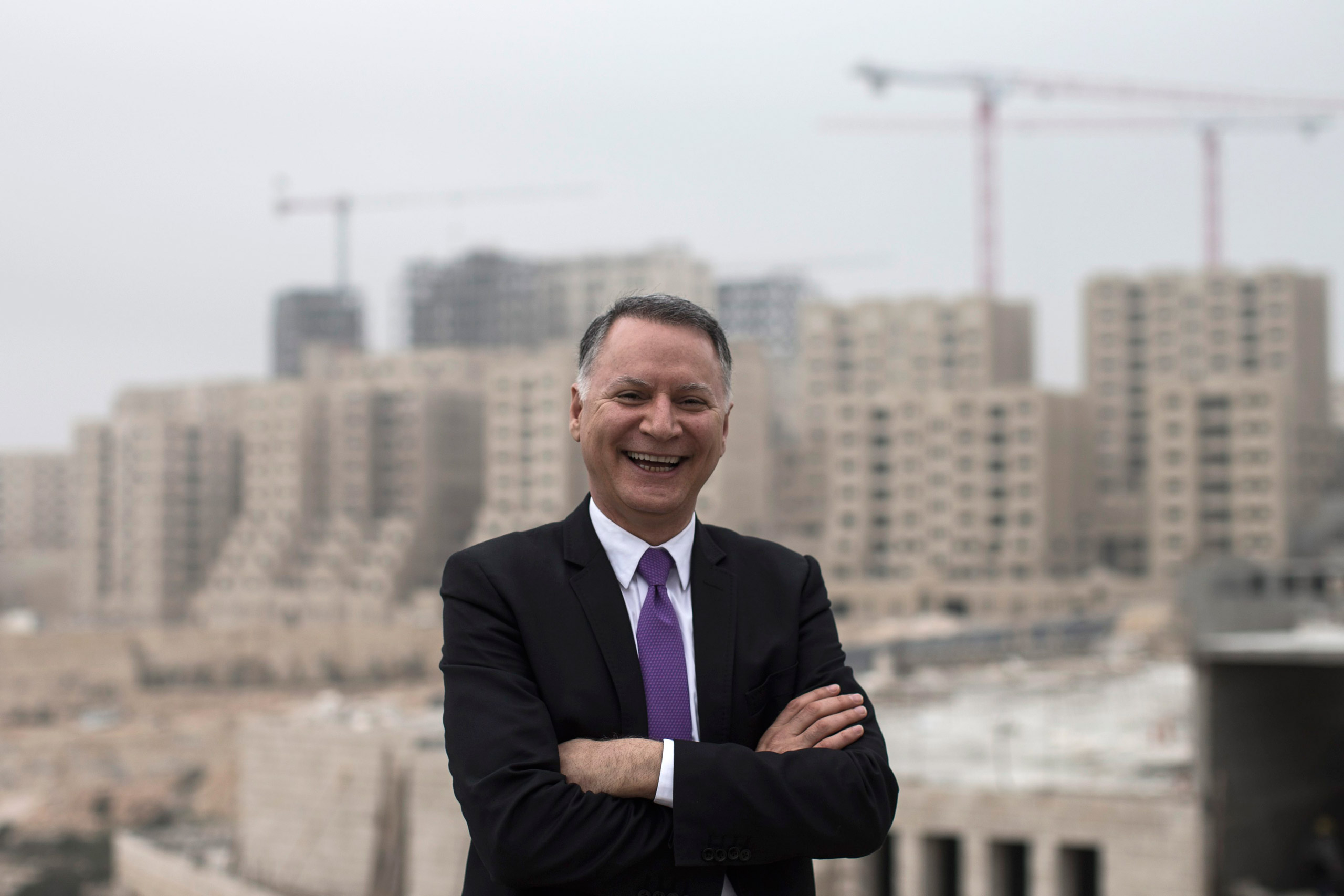 Bashar Masri, main investor of the new Palestinian city of Rawabi, in front of an apartment building under construction in Rawabi, West Bank, on Feb. 24, 2014.