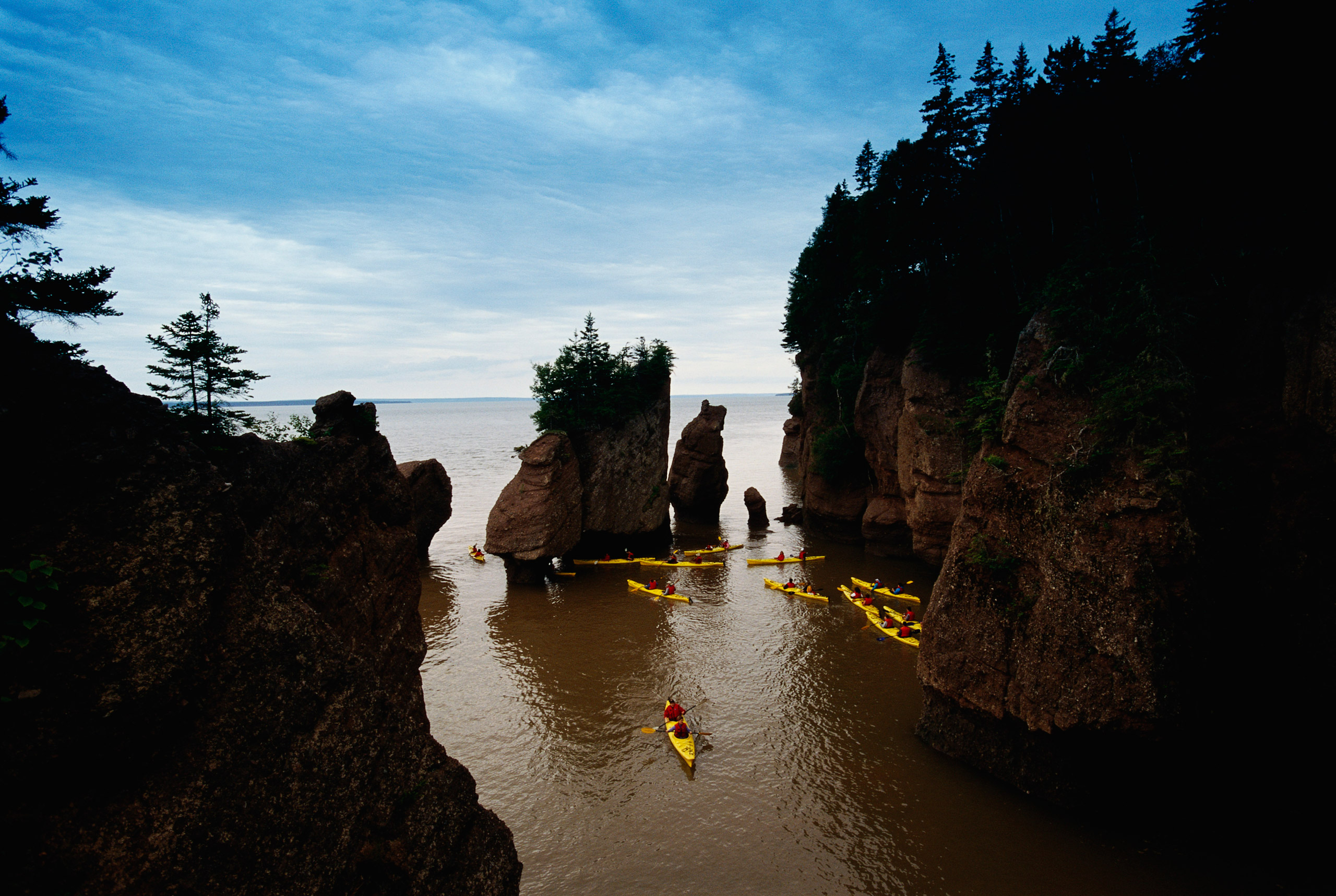 ca. 2002, New Brunswick, Canada, Canada --- Kayakers in the Bay of Fundy --- Image by © Richard T. Nowitz/CORBIS