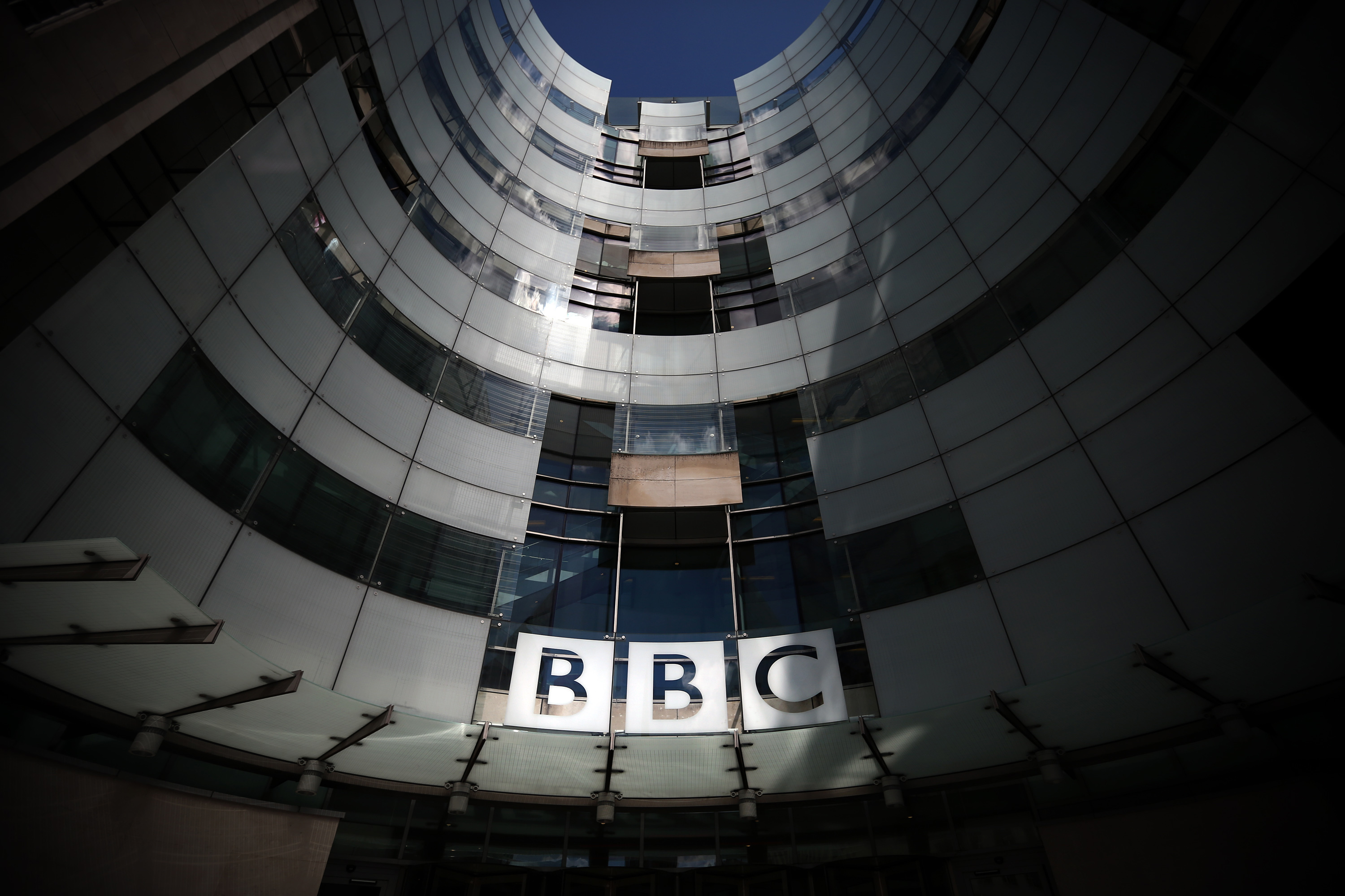 The logo for the Broadcasting House, the headquarters of the BBC, is displayed outside on July 25, 2015 in London.