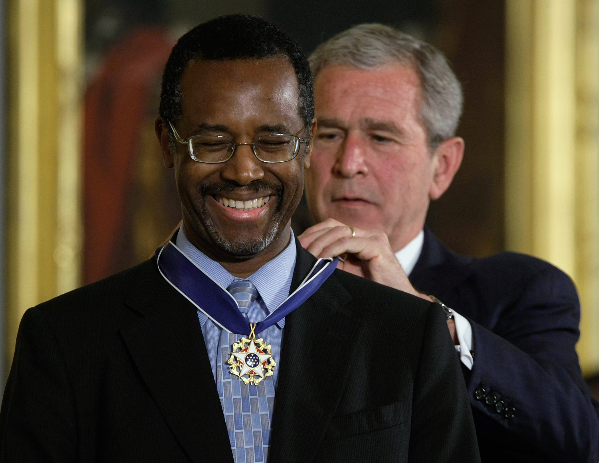 George W. Bush presents a Presidential Medal of Freedom to Ben Carson for his work with neurological disorders on June 19, 2008 at the White House in Washington.
